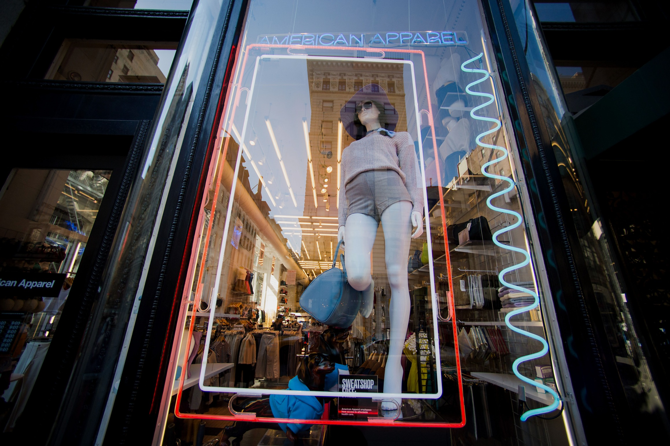 A mannequin stands in the window of an American Apparel Inc. store in New York, U.S.
