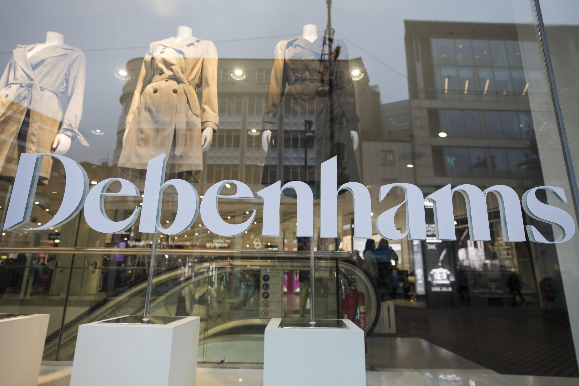 A Debenhams transfer sits on the window pane of a Debenhams Plc department store on Oxford Street in central London, U.K., on Monday, Feb. 4, 2019.