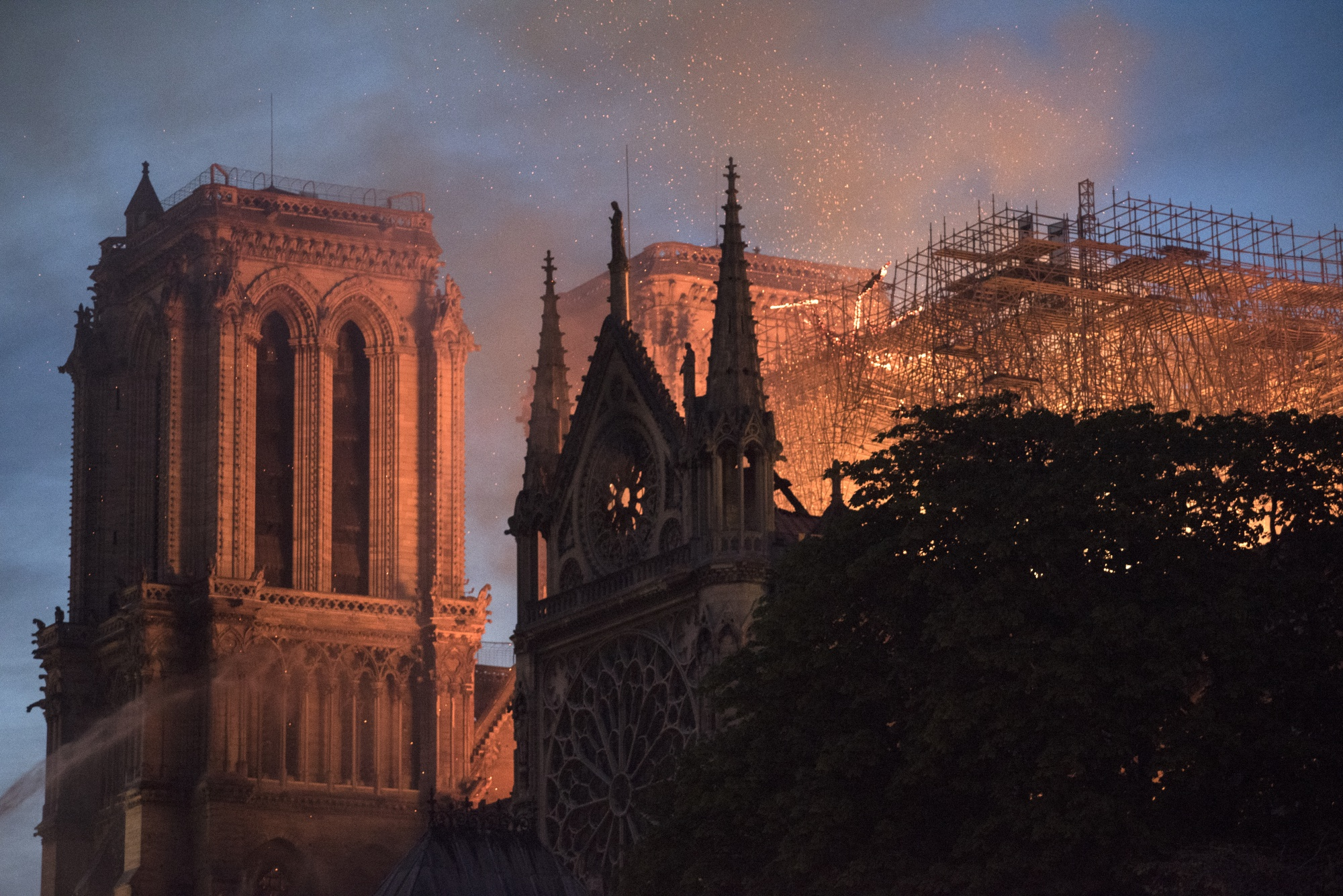 Flames and smoke rise from a fire at Notre-Dame Cathedral in Paris, France, on Monday, April 15, 2019