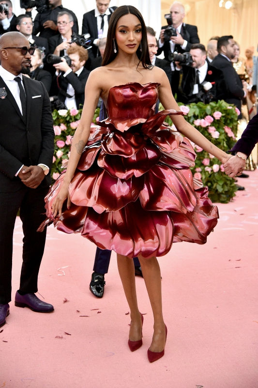 "Jourdan Dunn's custom Zac Posen x GE Additive x Protolabs rose gown features 21 total petals, averaging 20 inches in size and weighing 1 lb. each. The petals and interior bodice were 3D printed and finished with primer and color shifting paint (DuPont ""Twilight Fire"" Chromalusion)."