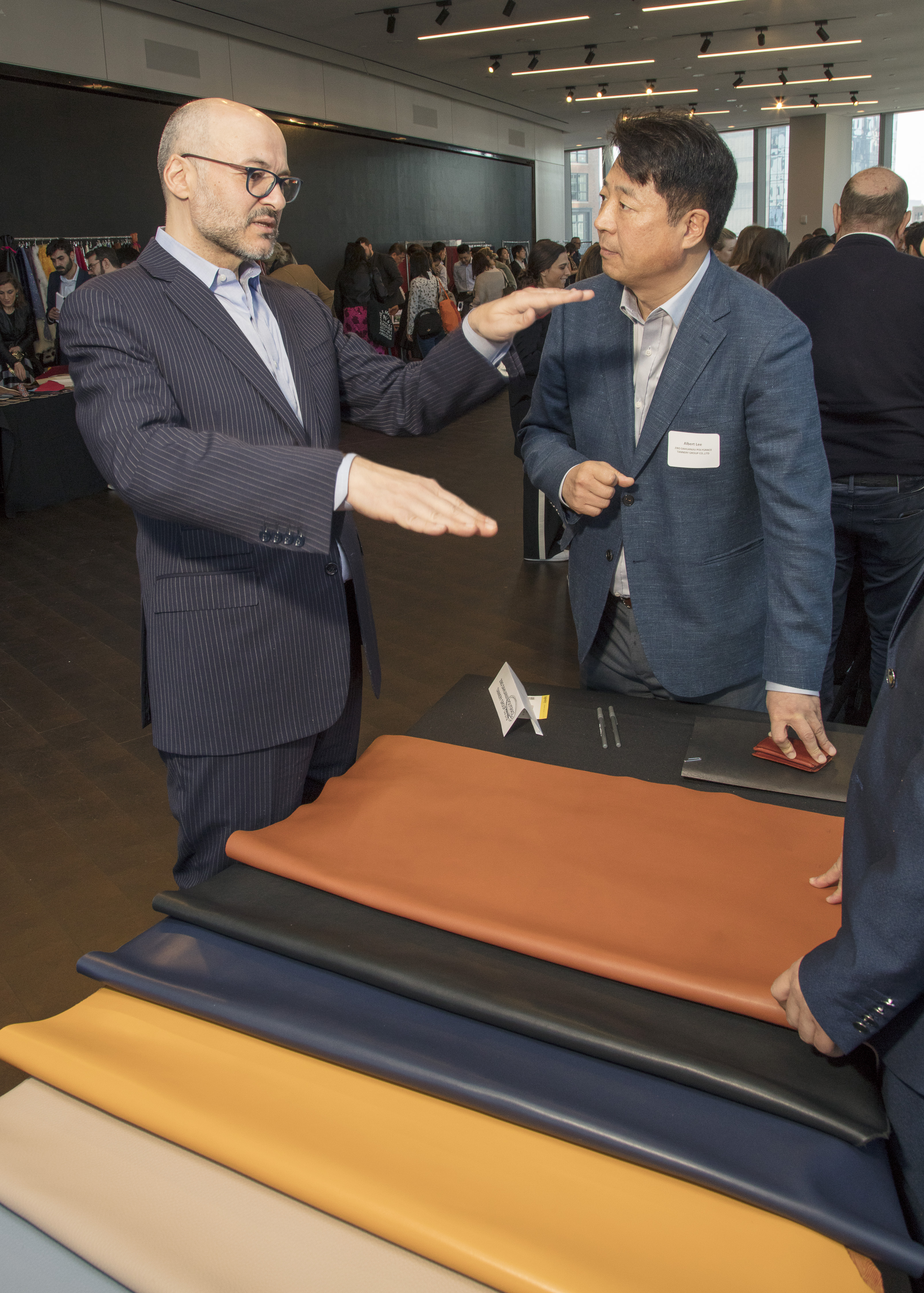 Tapestry ceo Victor Luis at one of the vendor tables.