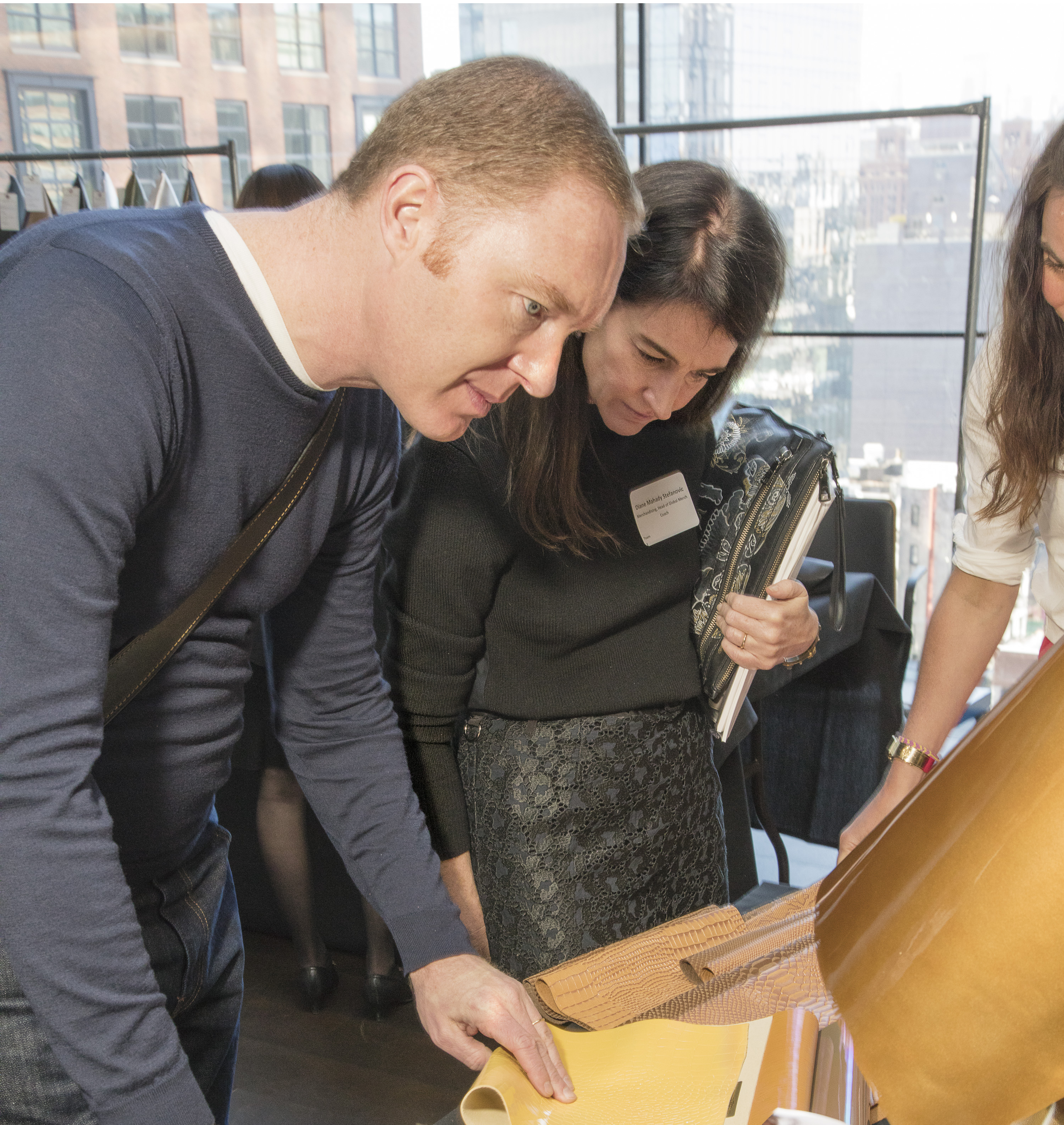 Coach's creative director Stuart Vevers reviewing leather options.