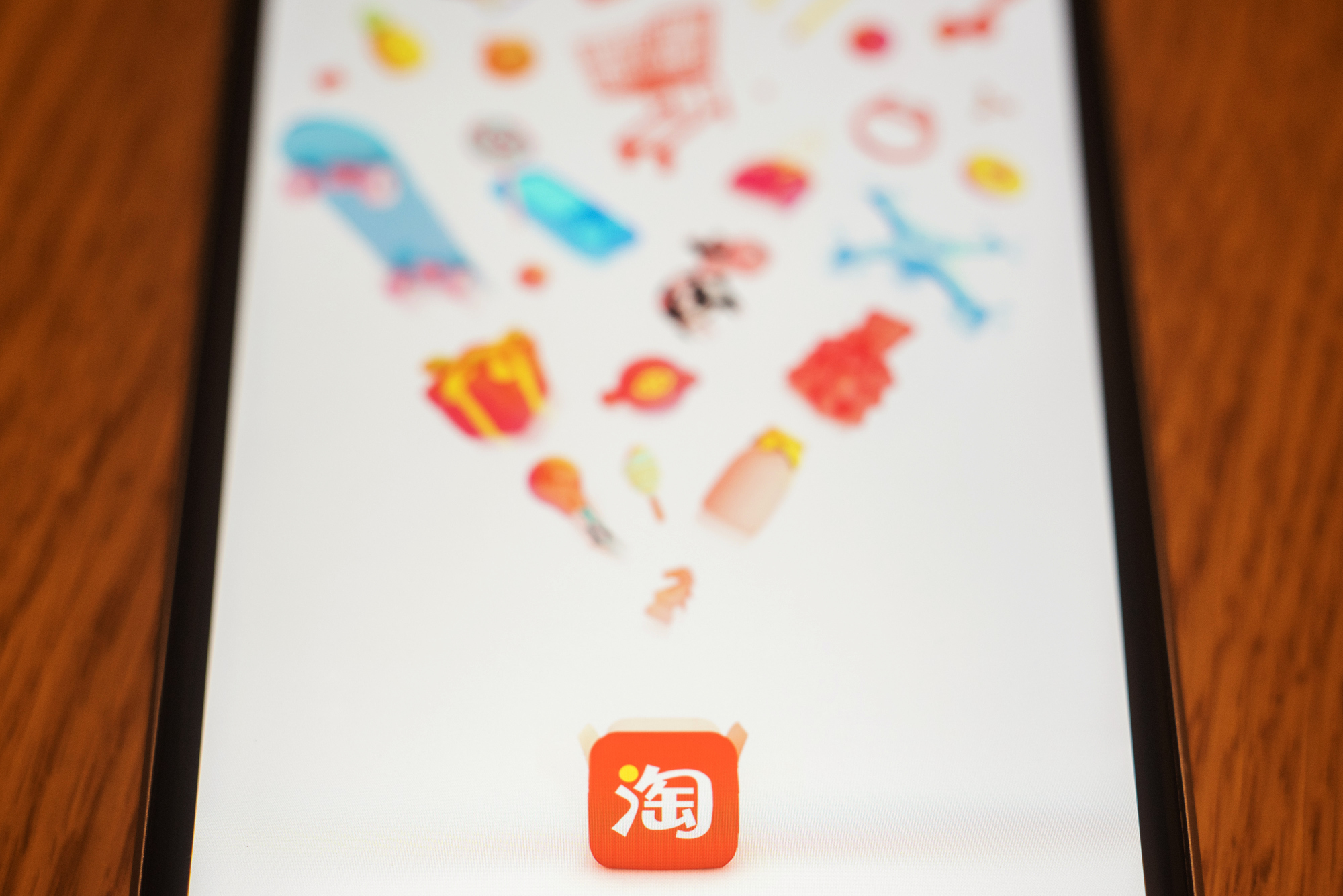 The loading page for Alibaba Group Holding Ltd.'s Taobao application is displayed on an Apple Inc. iPhone in an arranged photograph taken in Hong Kong, China, on Wednesday, July 26, 2017.