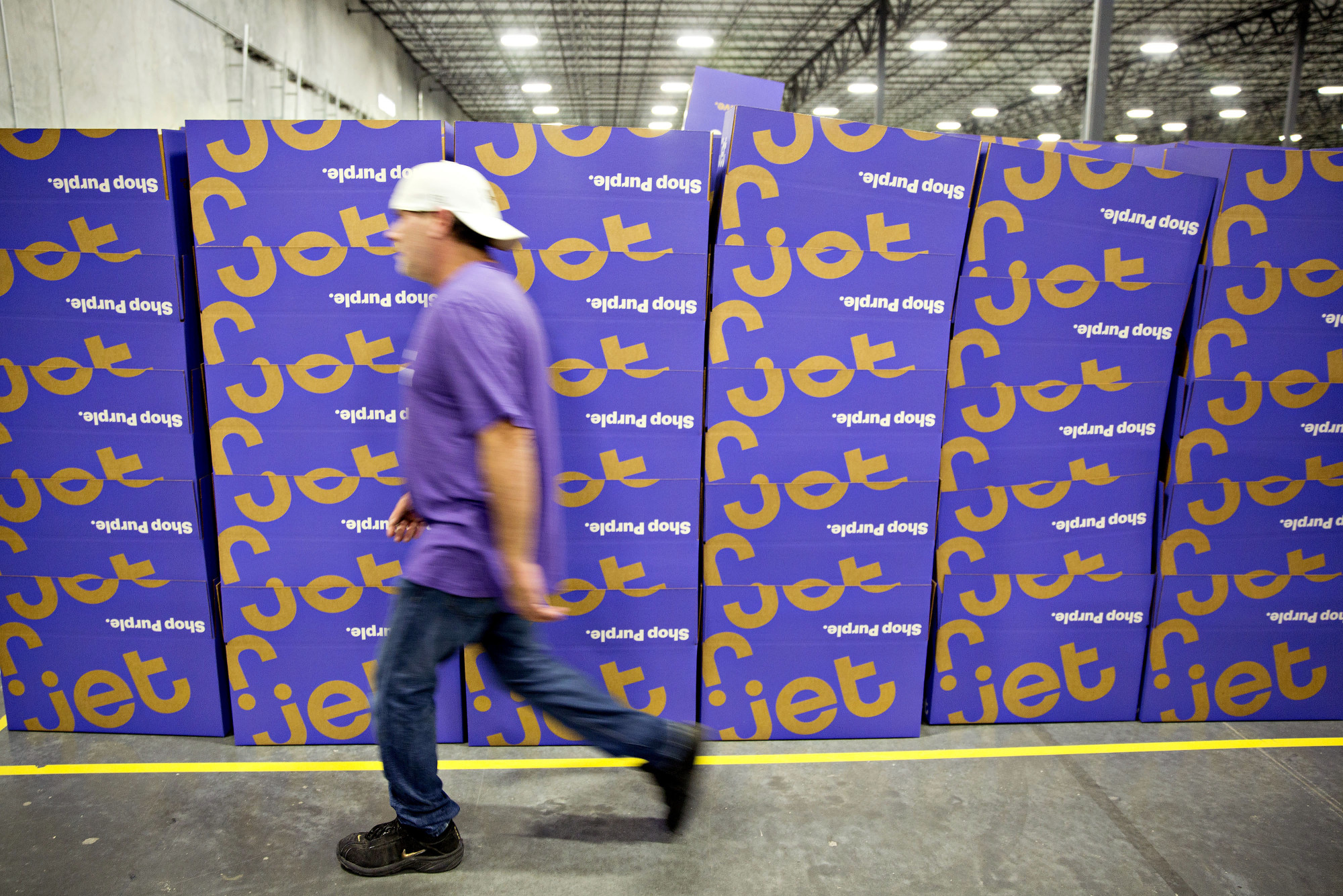 An employee walks past a stack of empty boxes at the Jet.com Inc. fulfillment center on Cyber Monday in Kansas City, Kansas, U.S.