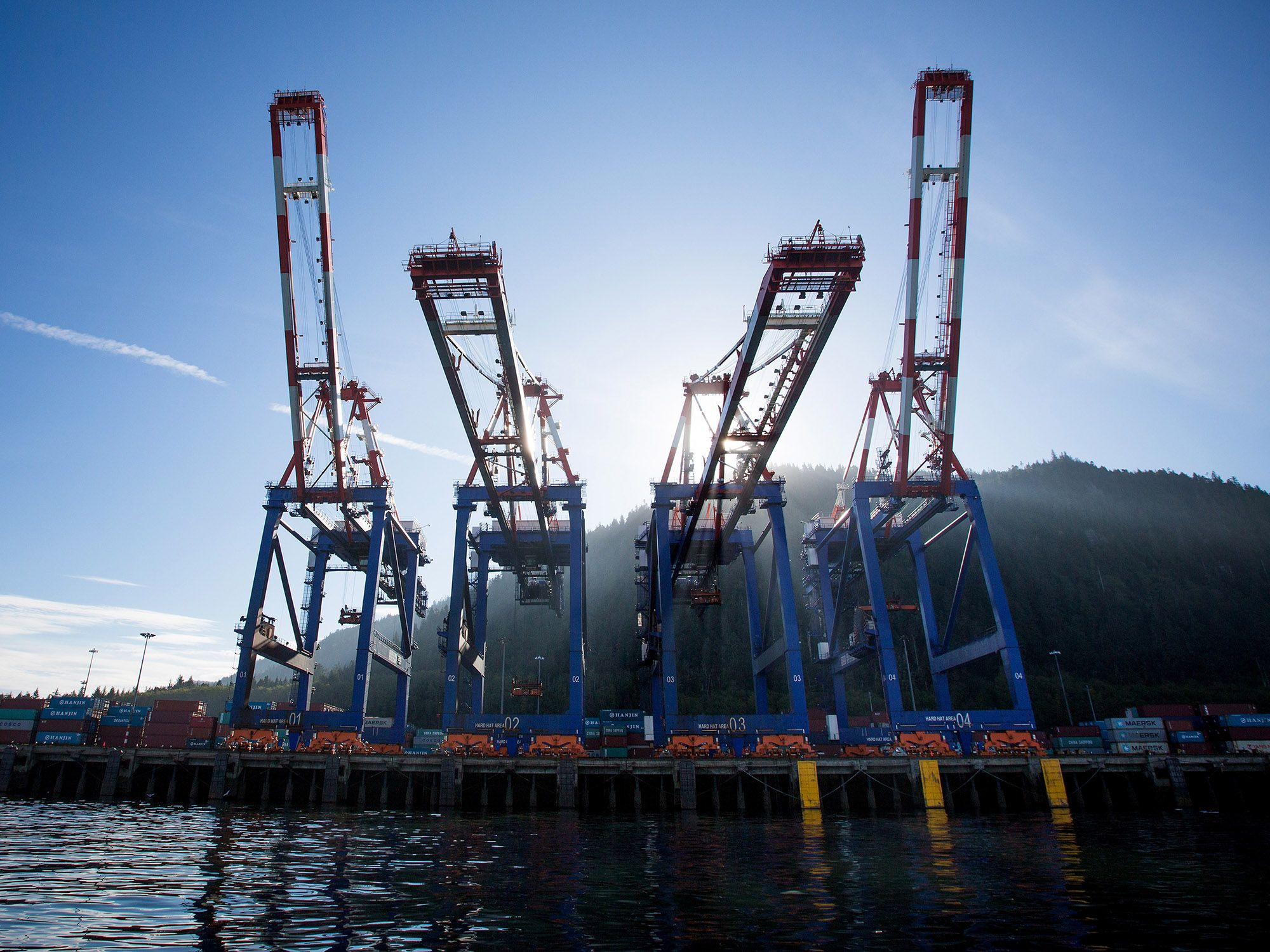 Container cranes stand at the Fairview Container terminal of the Port of Prince Rupert in Prince Rupert, British Columbia, Canada
