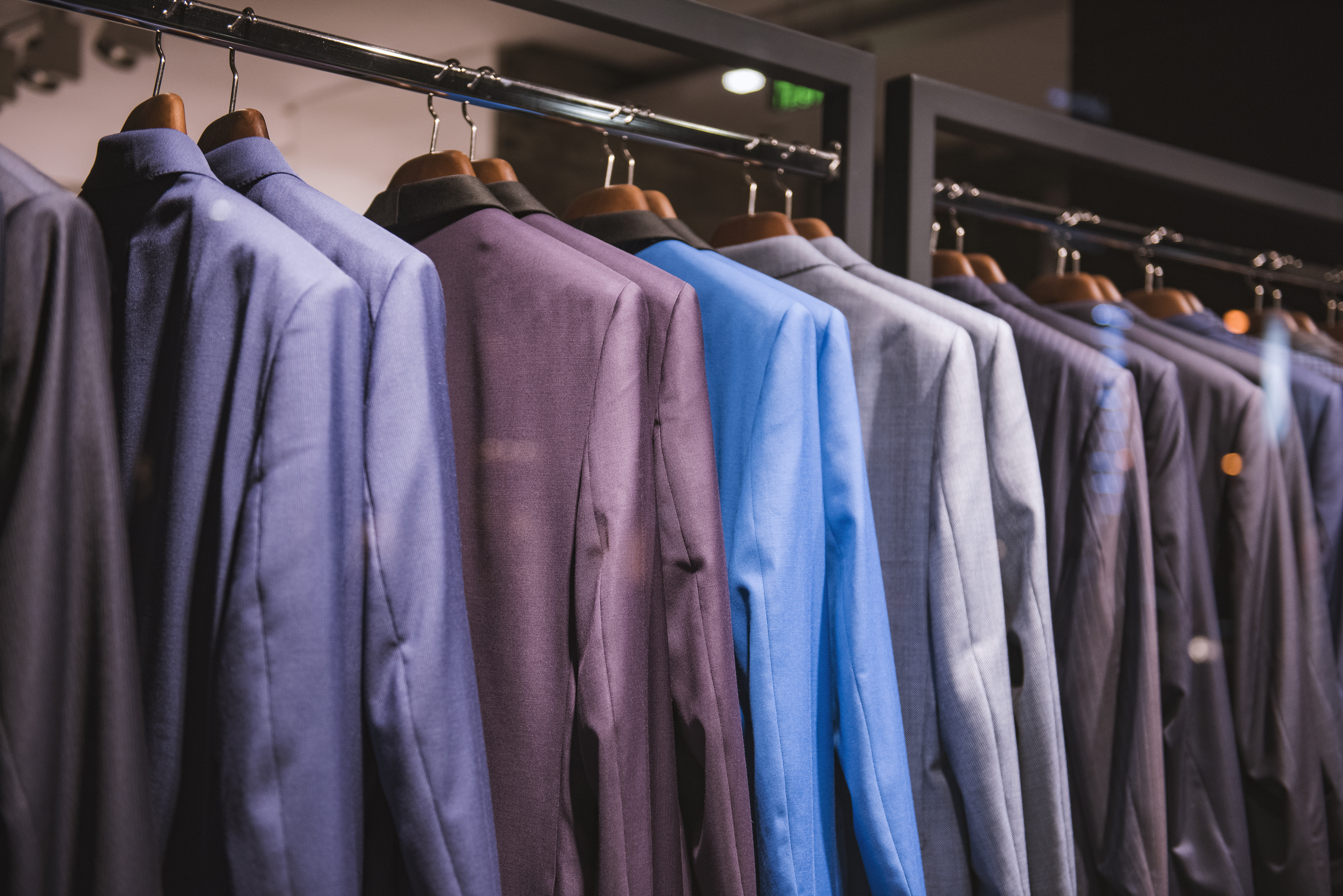 Rack of men's suits in a store