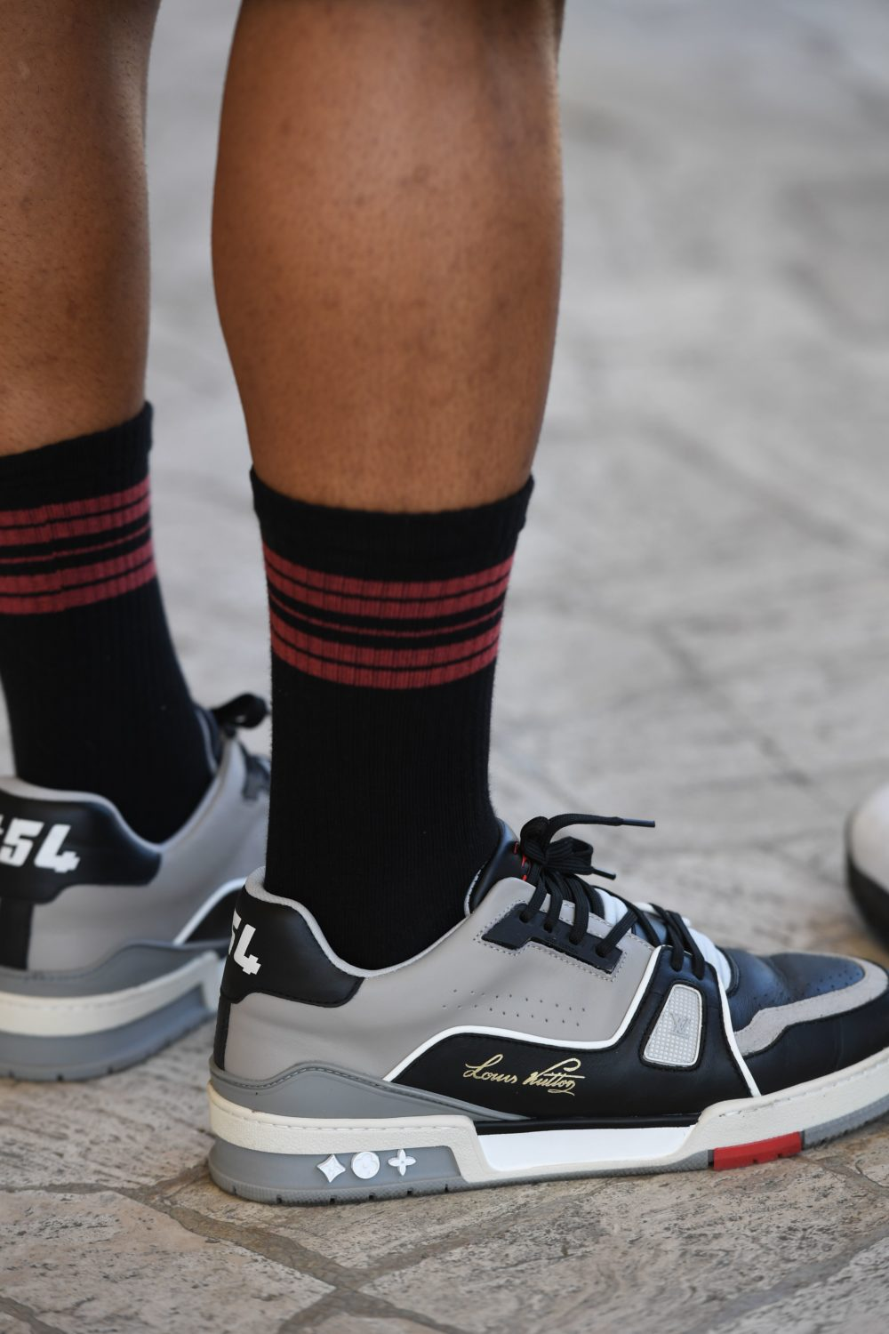 Luxury sneakers are a common sight on the streets at Pitti Immagine Uomo, as evidenced by these bold Louis Vuitton kicks going for $1,625 on StockX.