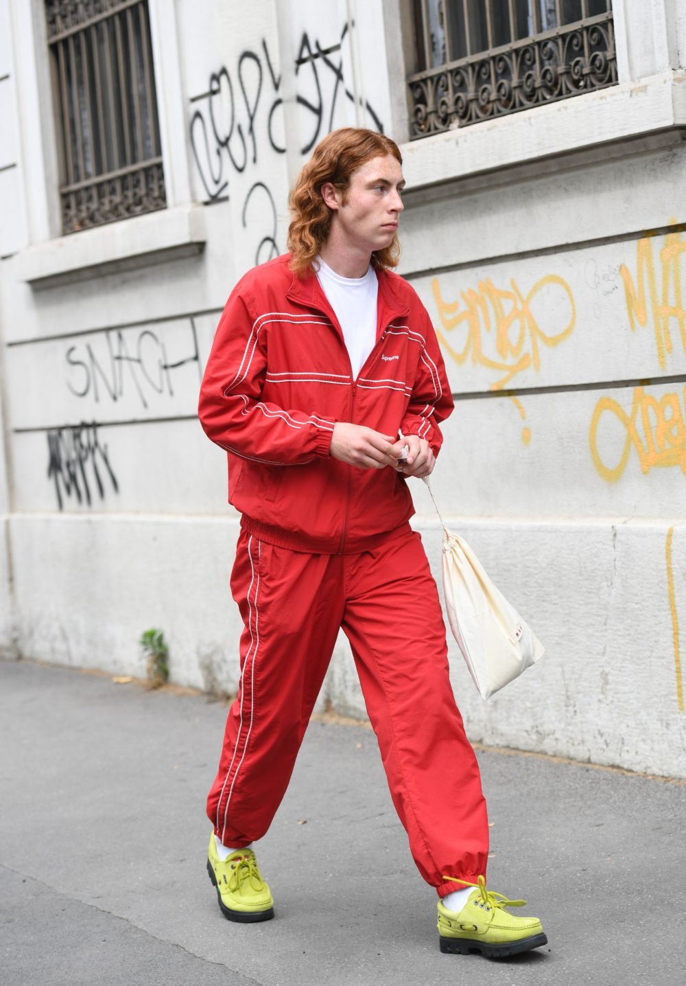 The brights are all right: a ginger goes for bold in a red track suit and neon geriatric-style shoes.