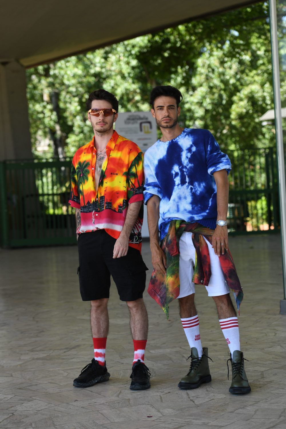 Brights and tie-dye up top pop against neutral footwear set off by candy-cane-colored socks.