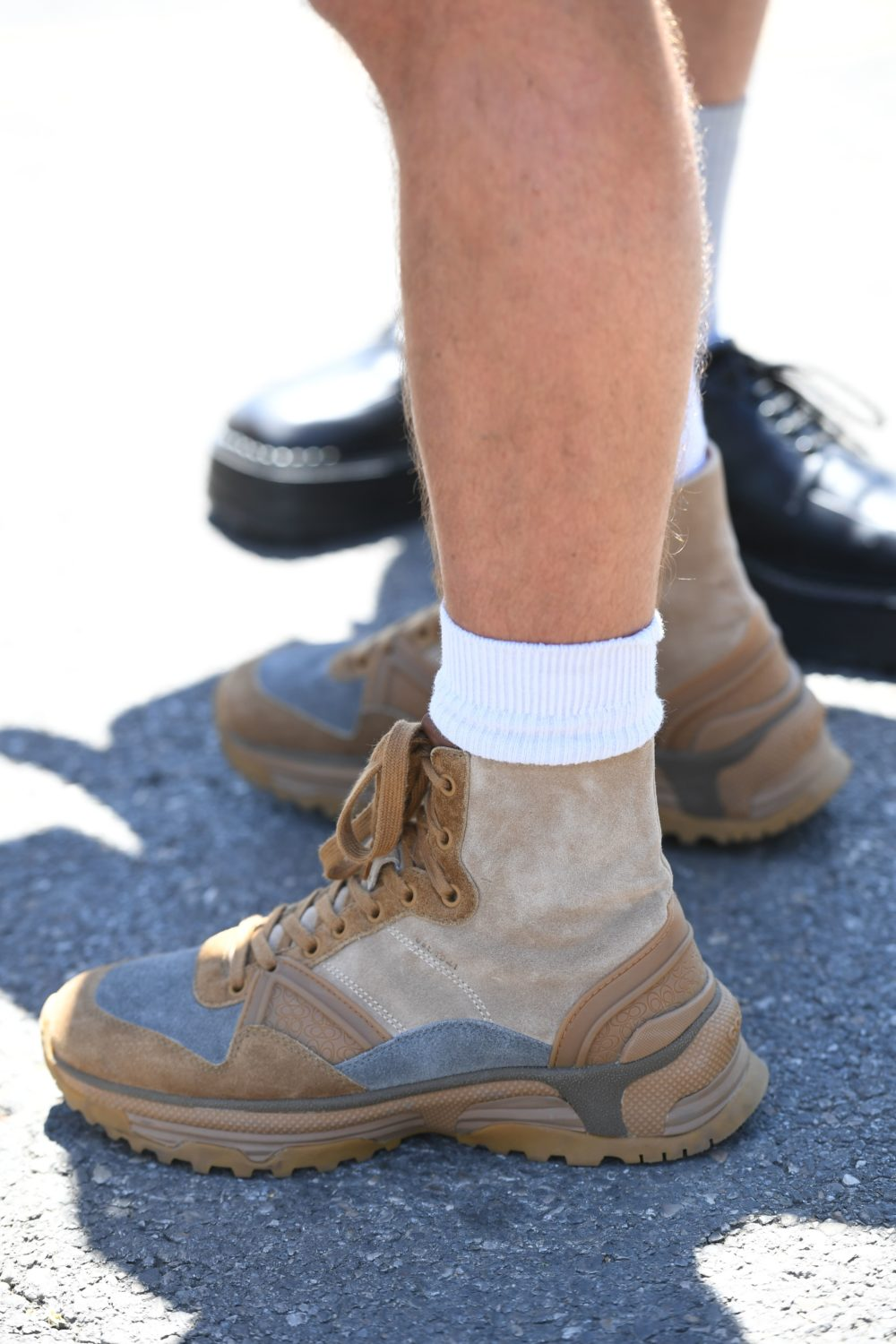 Proof that hikers are taking their turn in the fashion spotlight, one stylesetter is dressed to hit the trails after taking in the latest trends in men's wear.