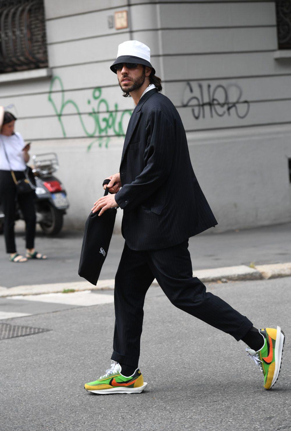 Neon Nikes jazz up a straightforward black-and-white ensemble.