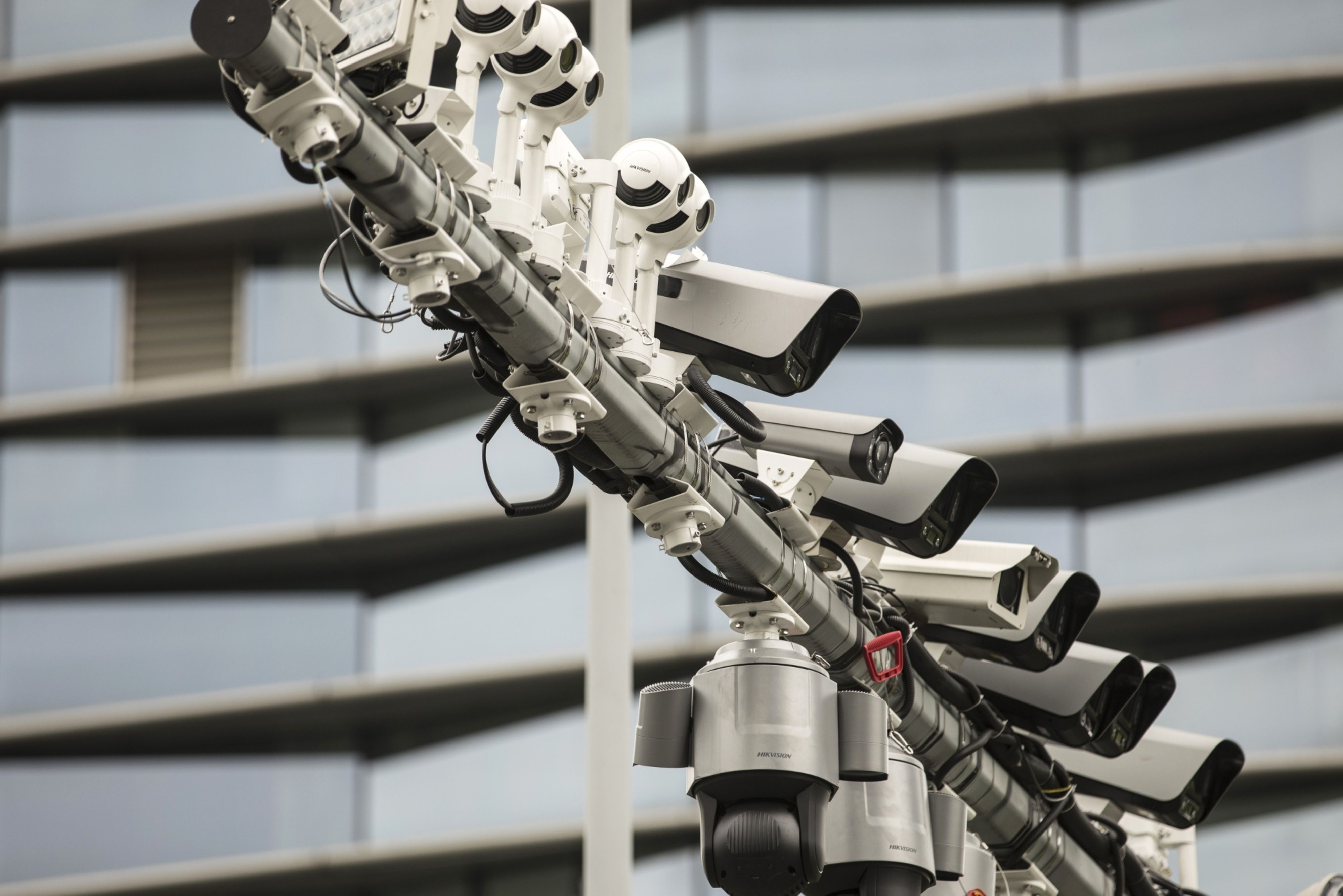 Surveillance cameras fill up a pole at a testing station near the head quarters of the Hangzhou Hikvision Digital Technology Co., Ltd. in Hangzhou, China