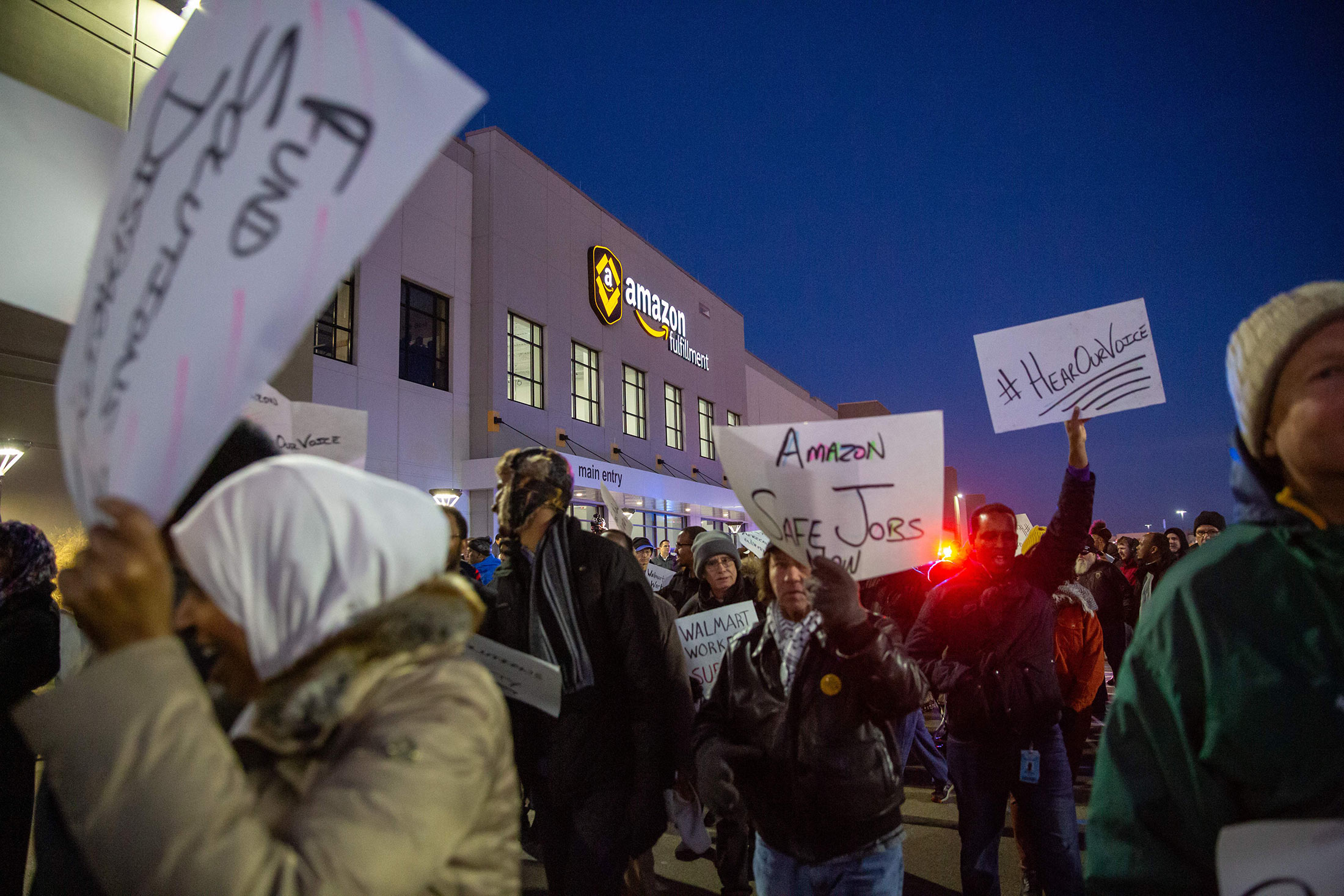 Demonstrators protest at the Amazon fulfillment center in Shakopee, Minnesota, on Dec. 14, 2018.