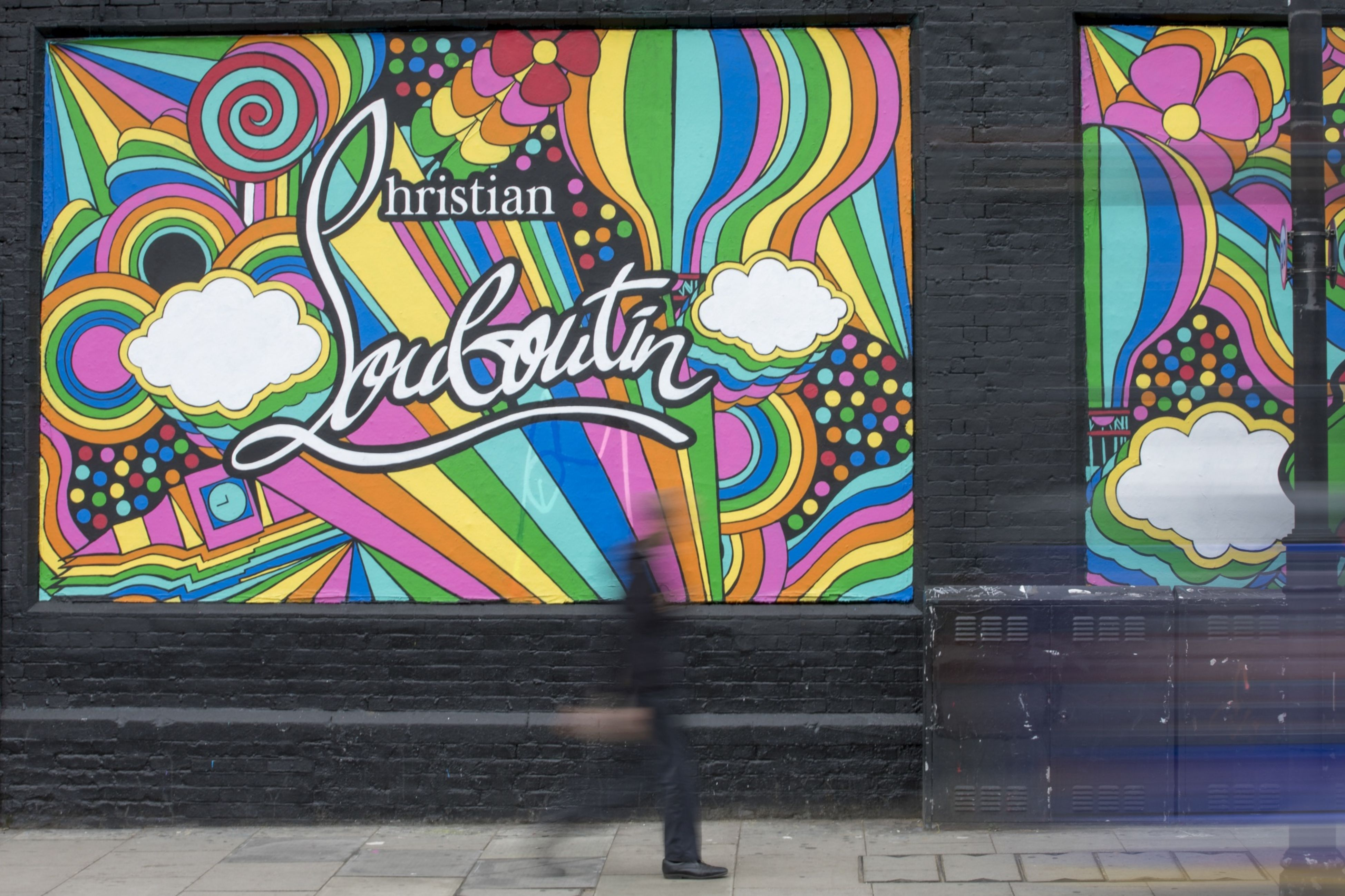 A mural Christian Louboutin stands on display on Great Eastern Street, East London, U.K.
