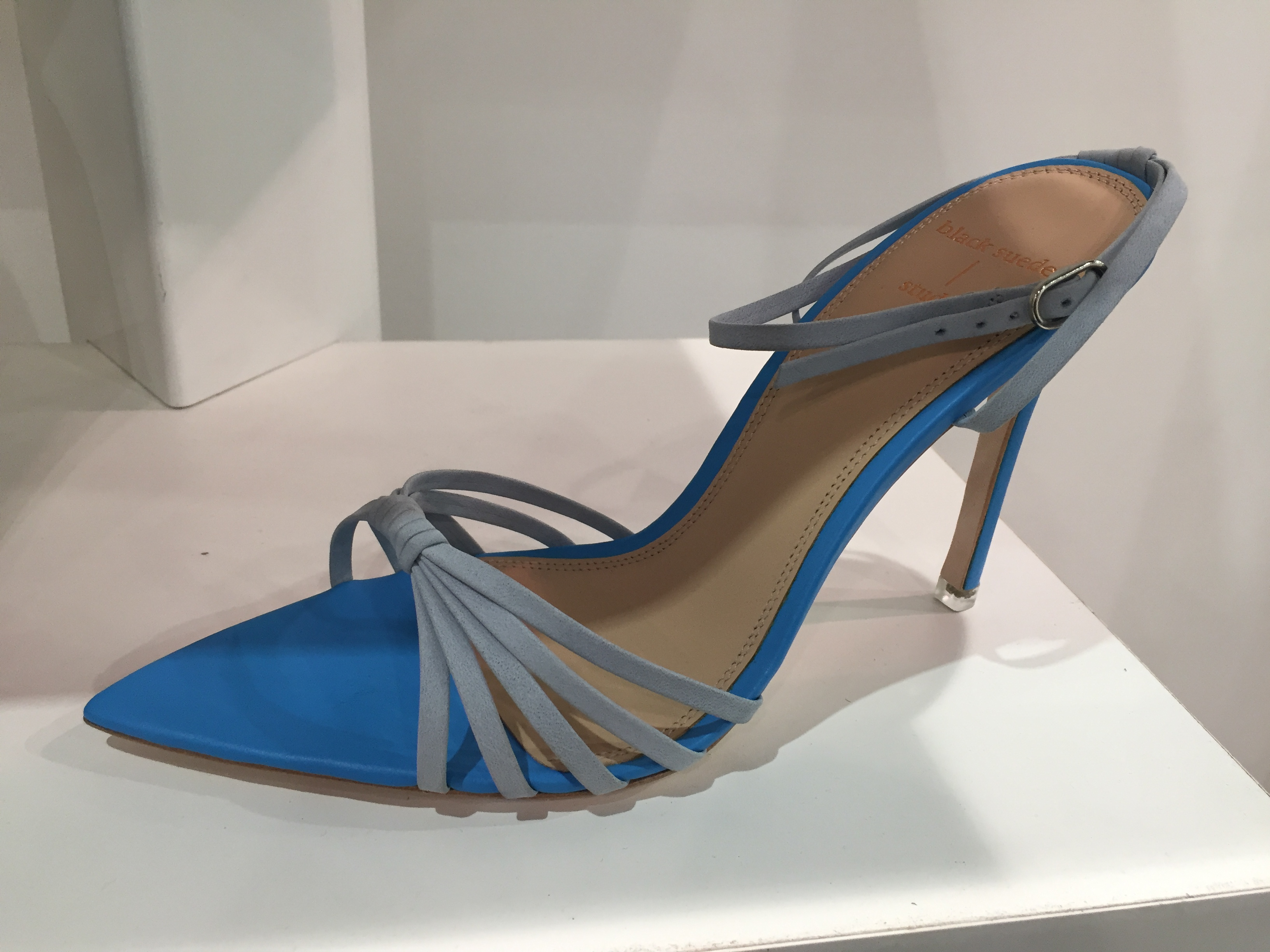 A pointed-toe heeled sandal from Black Suede.