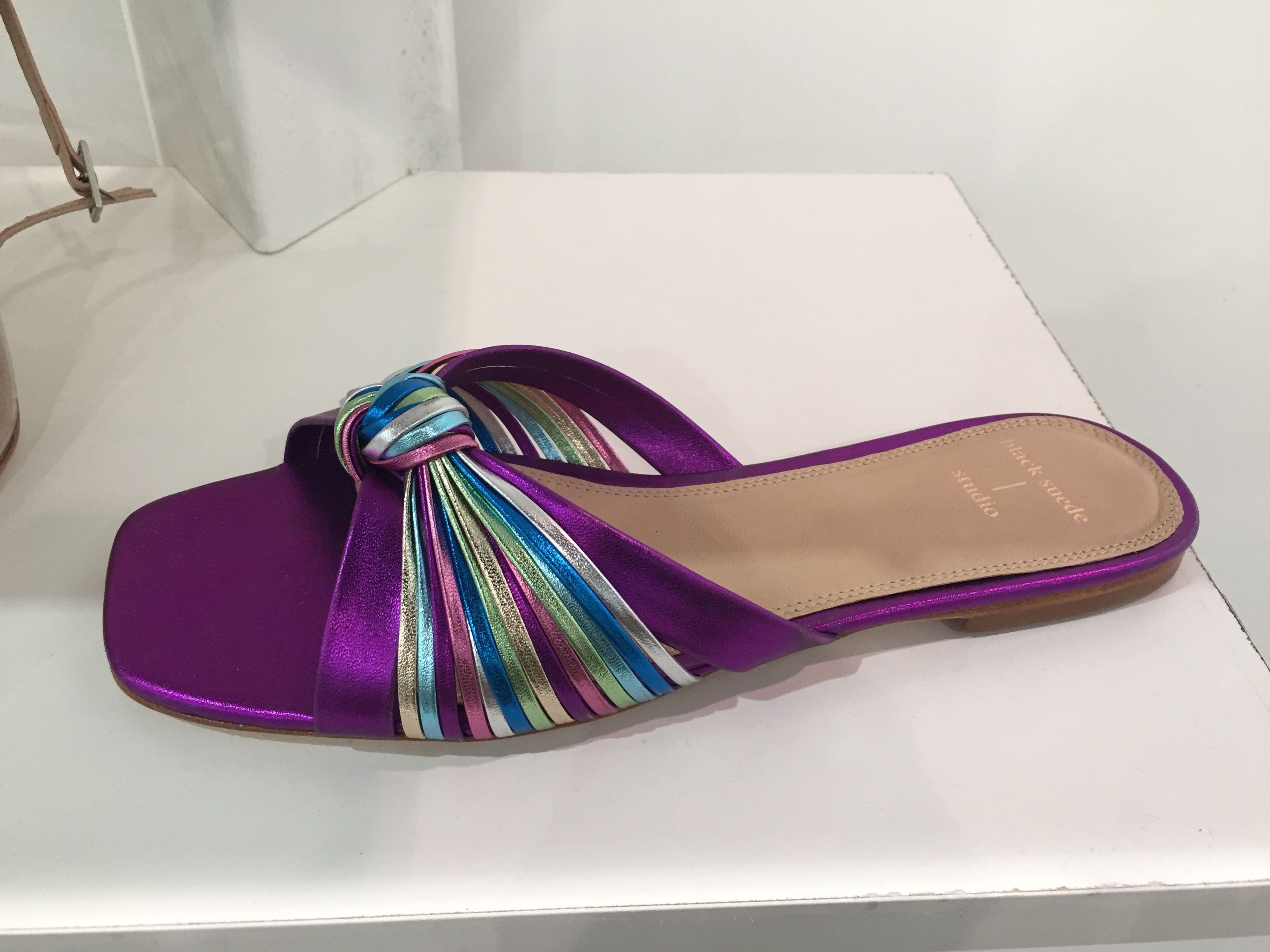 A metallic, jewel-toned slide from Black Suede.