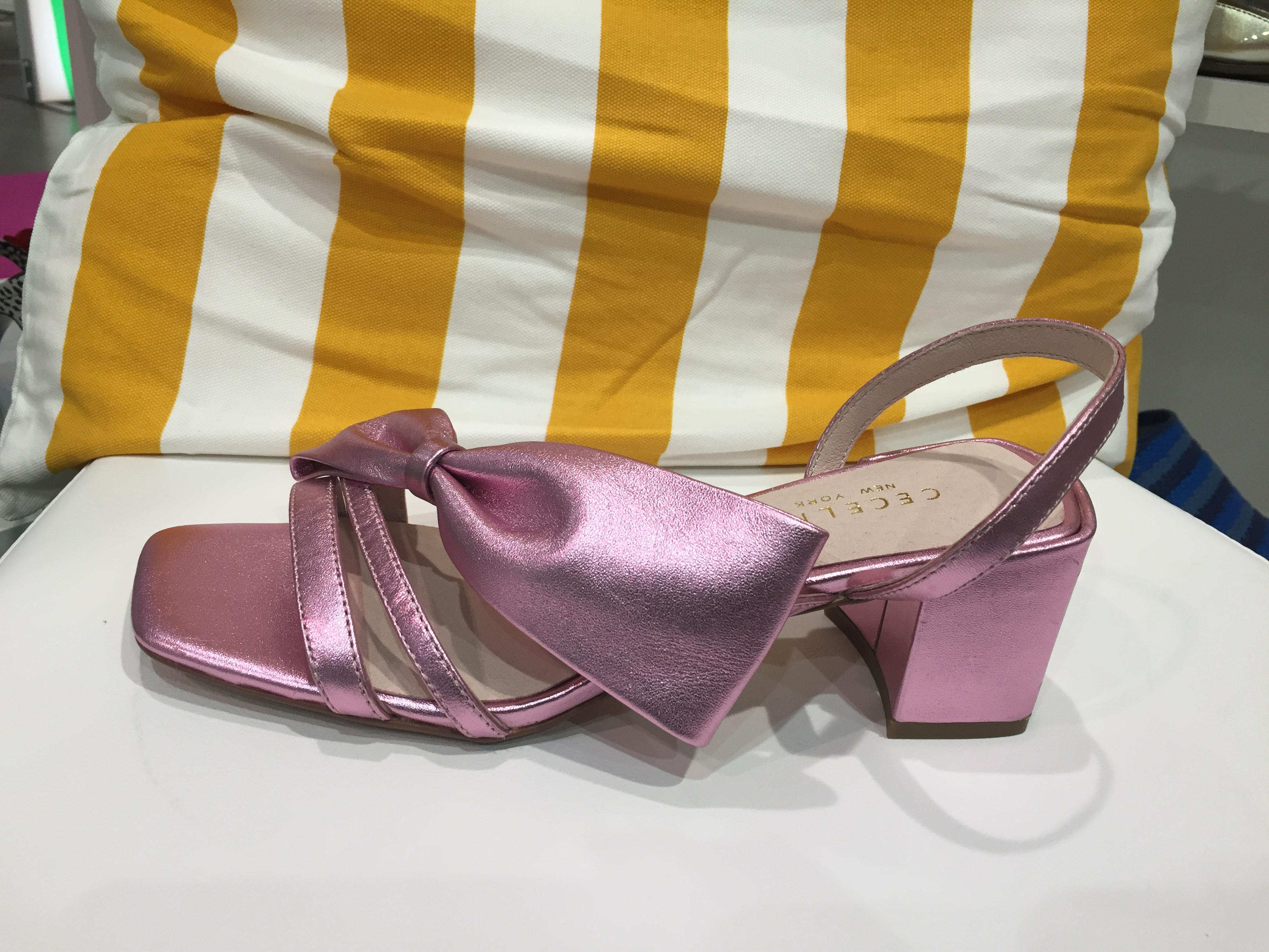 A metallic pink block heel style with a bow from Cecelia New York.