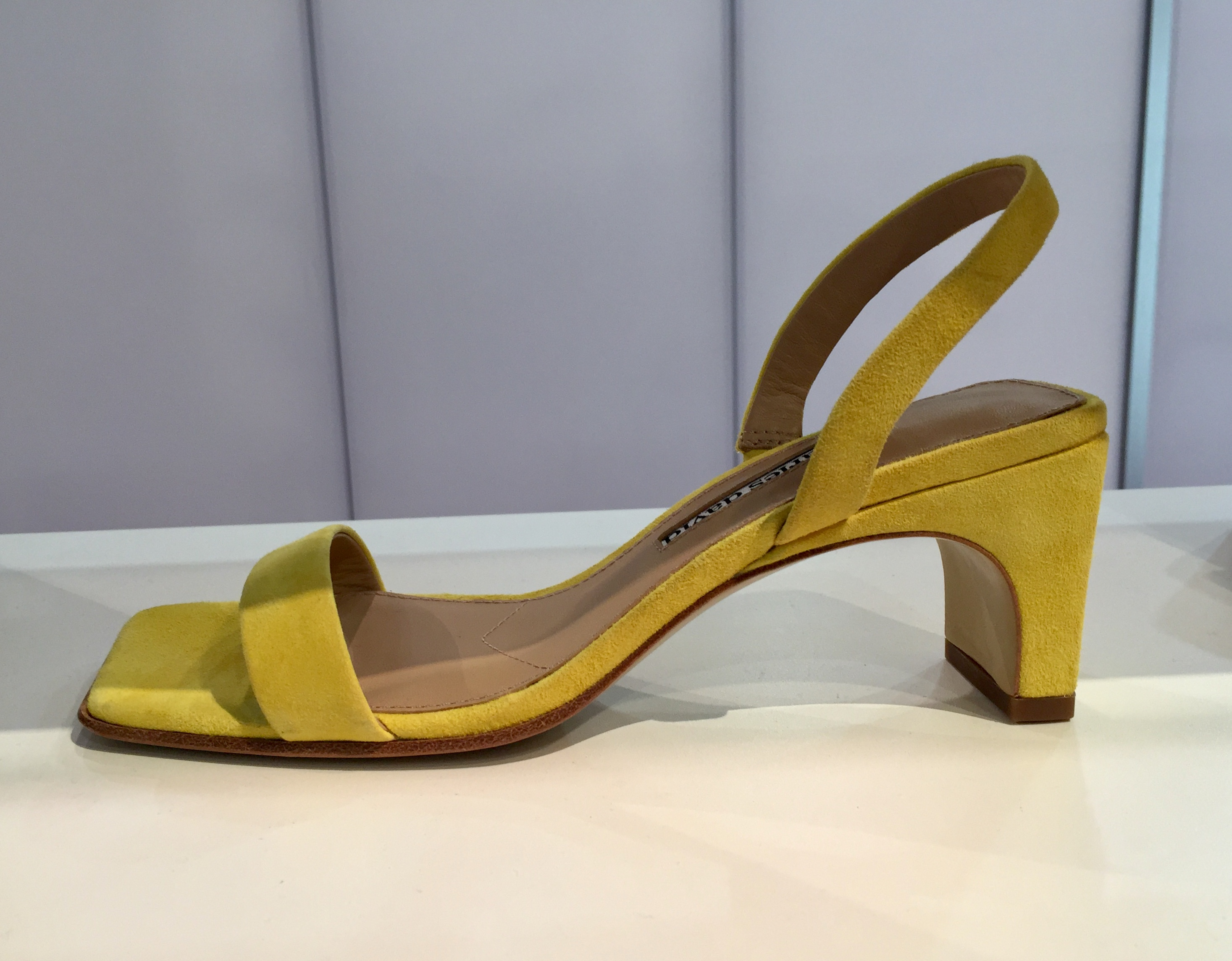 A suede slingback sandal in chartreuse from Charles David.