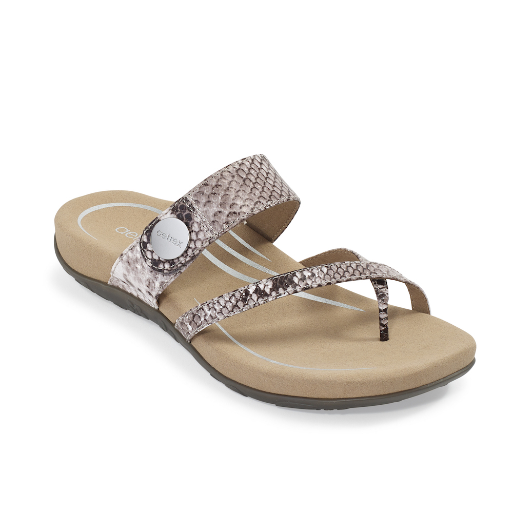 Adjustable toe loop sandal with a hook & loop closure.