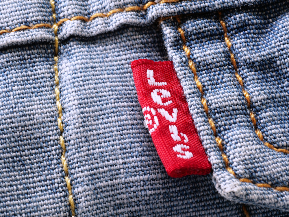 Yves saint laurent and levis settle suit regarding red tab