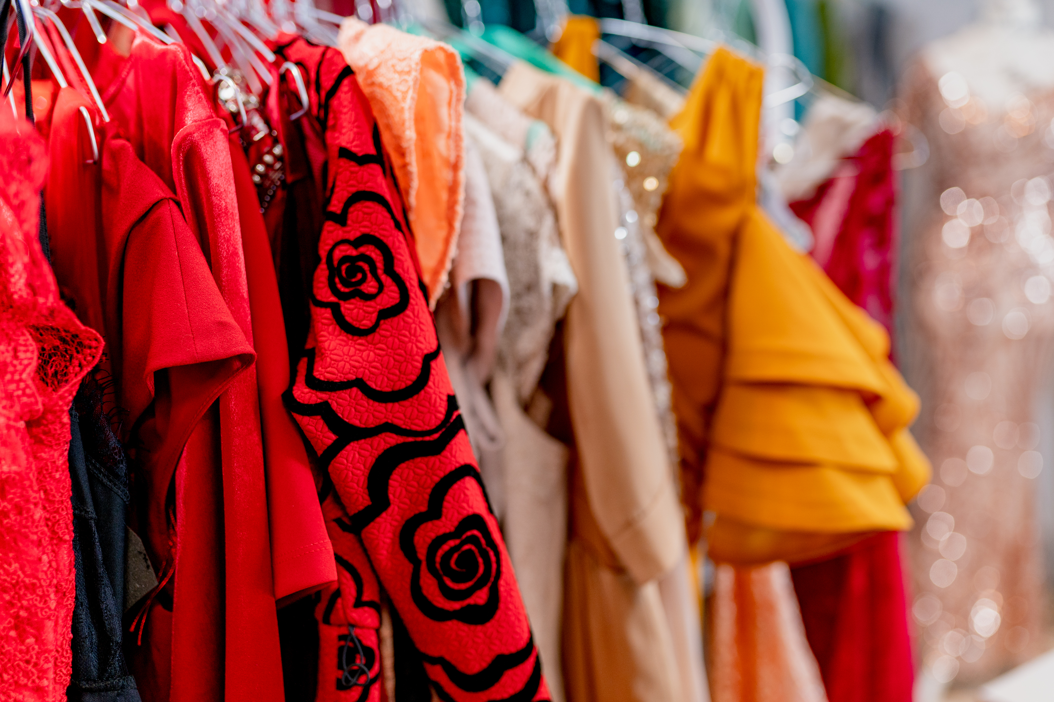 dresses hanging on a clothing rack