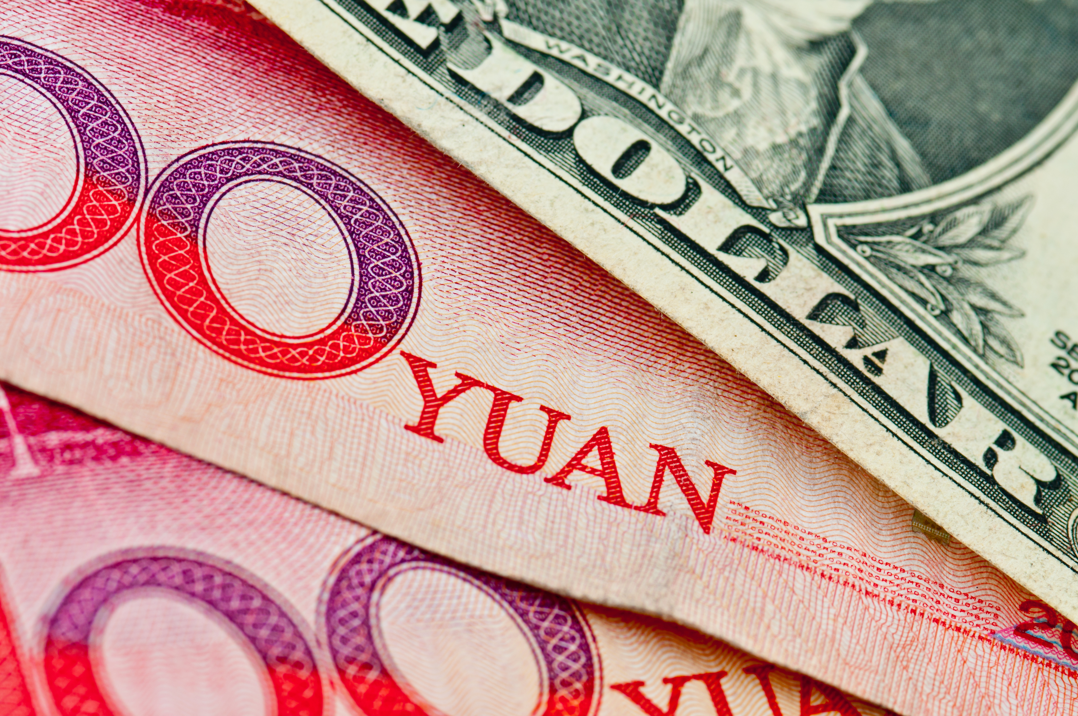 close up of yuan currency and us dollar
