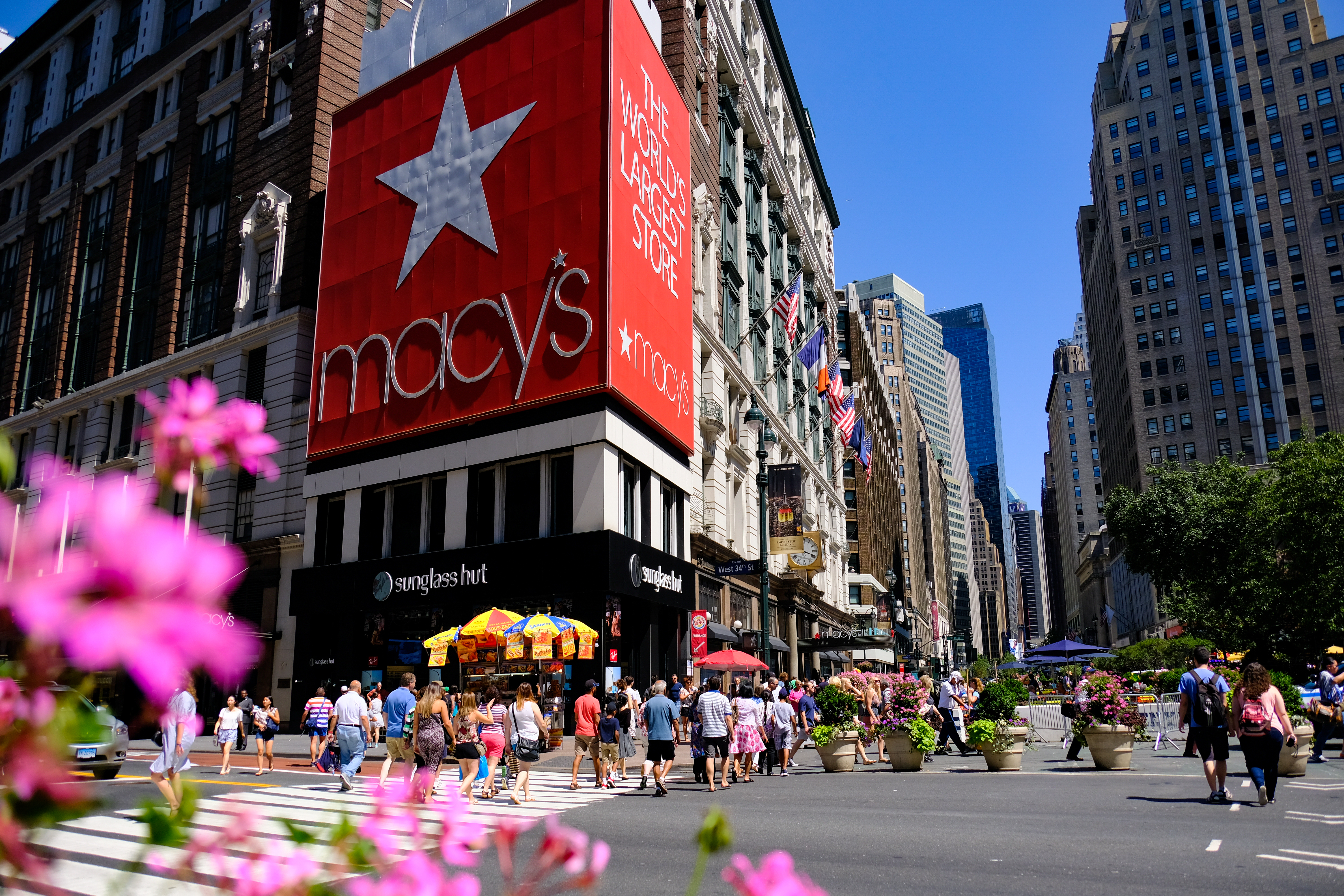 Macy's Herald Square Flagship Department Store in Midtown Manhattan with people crossing the street in front of it