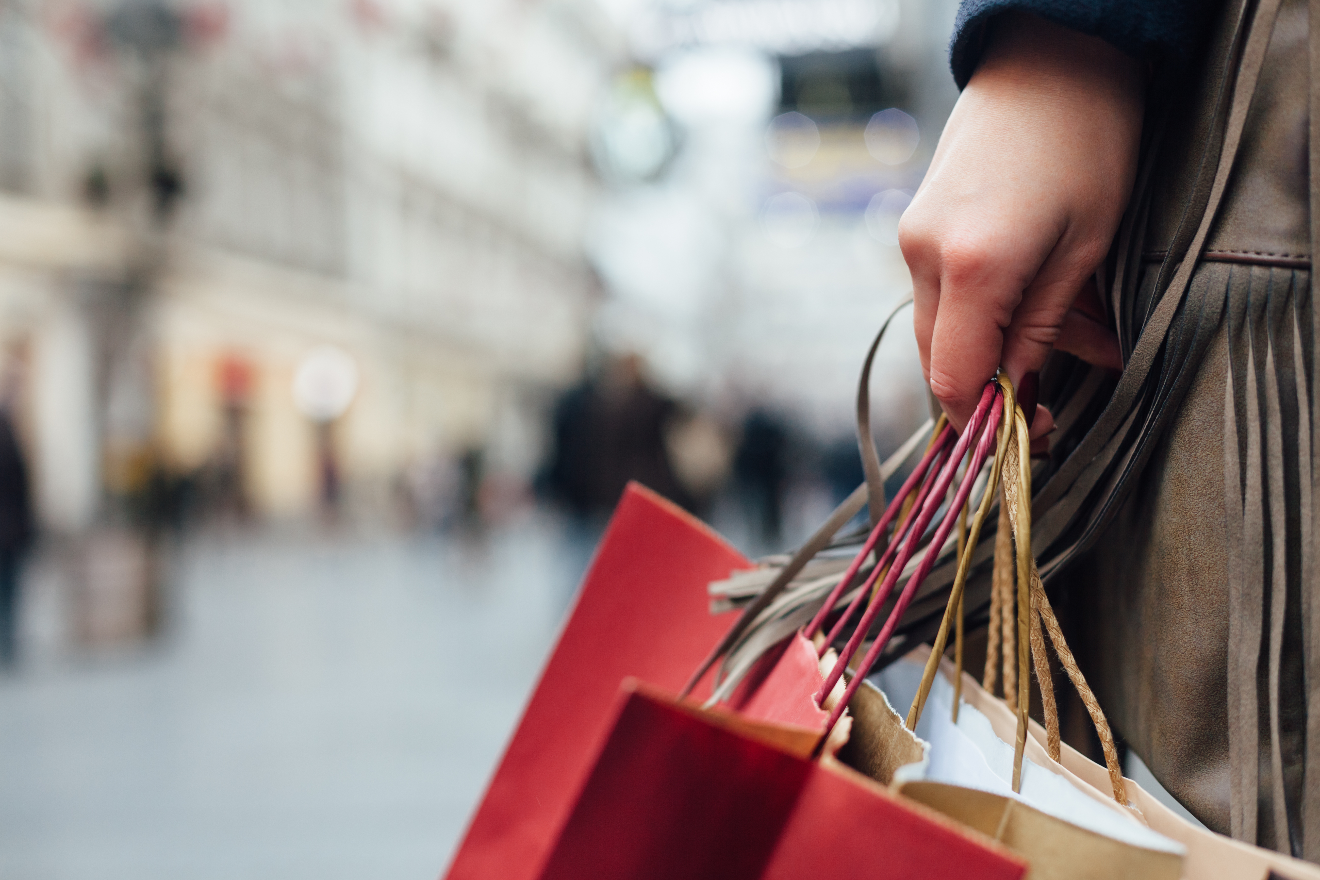 Close up of shopper holding shopping bags