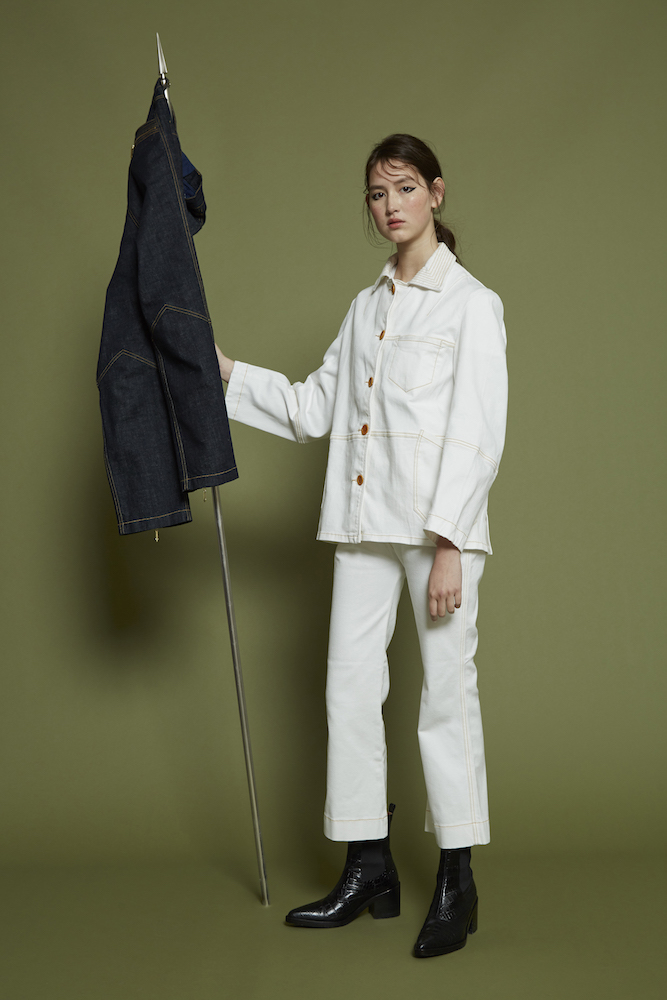 Outland Denim and Karen Walker teamed on a six-piece capsule collection that reimagines workwear pieces for modern aesthetics.