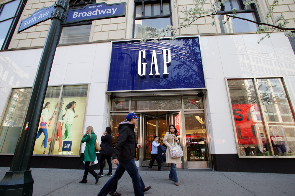 Gap Inc.'s board said president and CEO Art Peck is stepping down, while Genesco promoted Mimi Eckel Vaughn to president and CEO.
