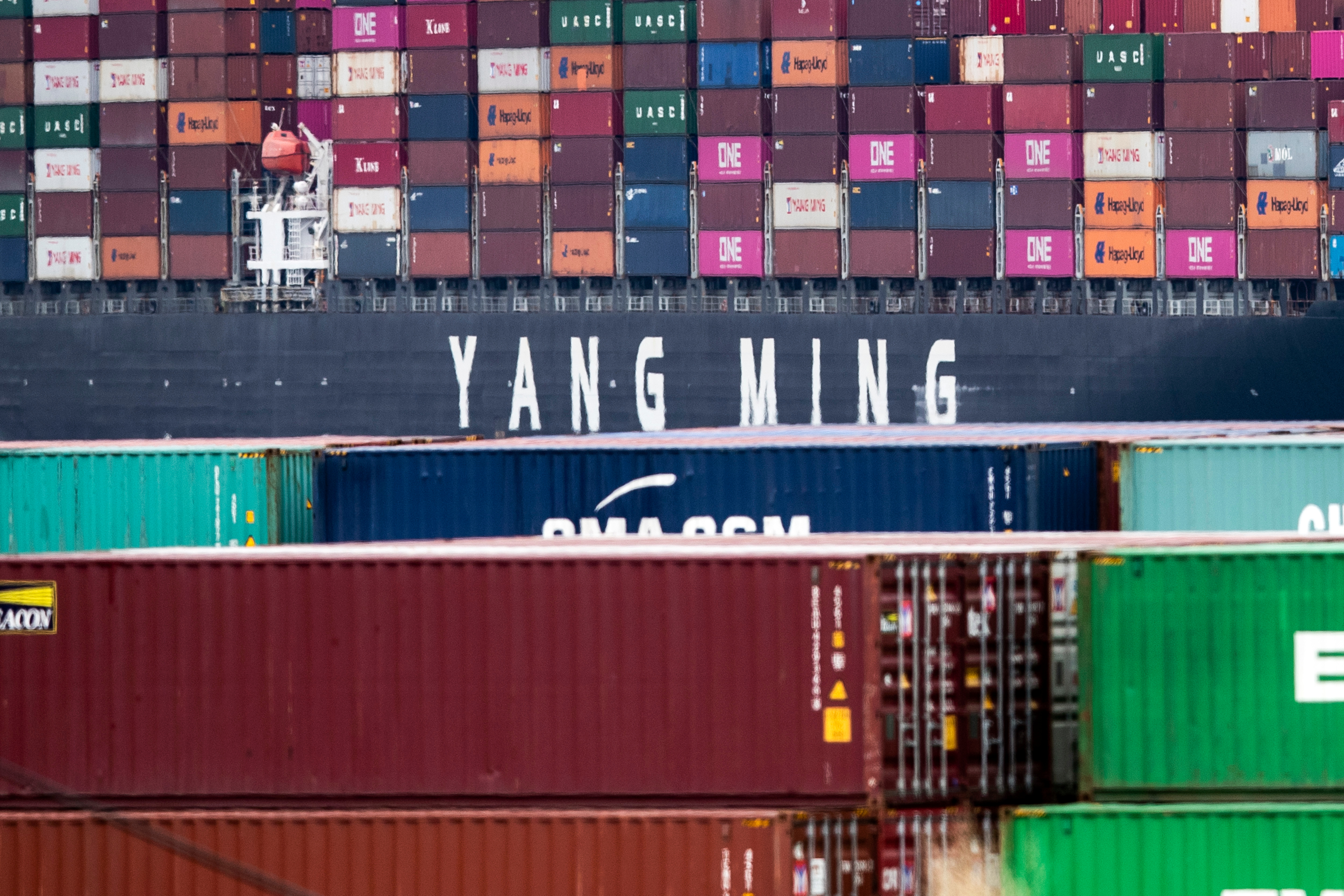A cargo ship of Taiwanese transport company Yang Ming, loaded with containers, sits docked at the Los Angeles Port, California, USA, 13 May 2019.