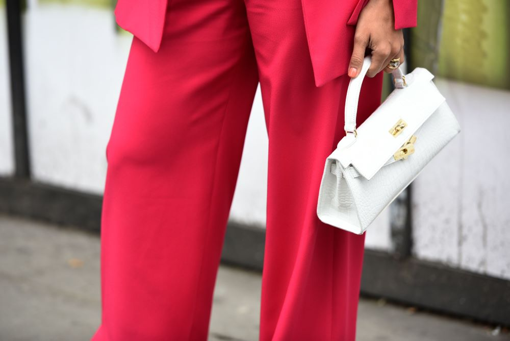 An Intelligence Node survey says a 100 percent U.S. tariff on France could ding French luxury handbags but benefit American-made brands.