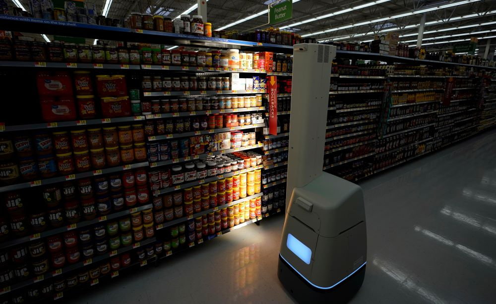 At the AI Summit in New York, present and former Walmart execs explained how AI and robotic process automation can benefit retail.