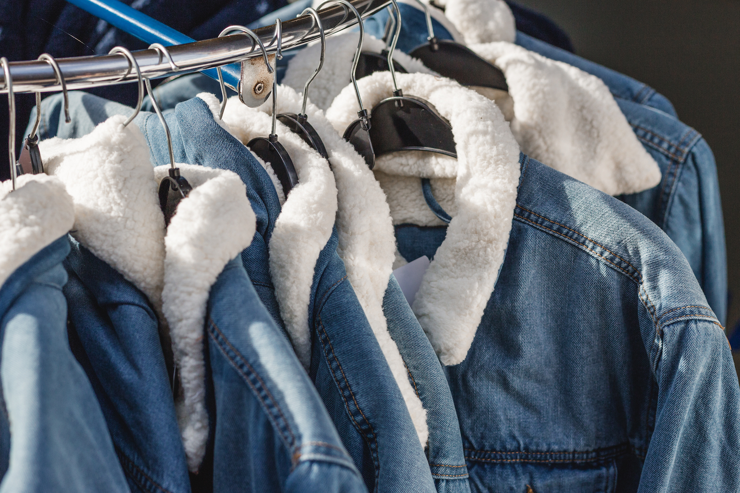 Denim brands including Sacai, Monki and American Eagle winterize jean jackets with cozy sherpa lining, fur collars and quilted details.