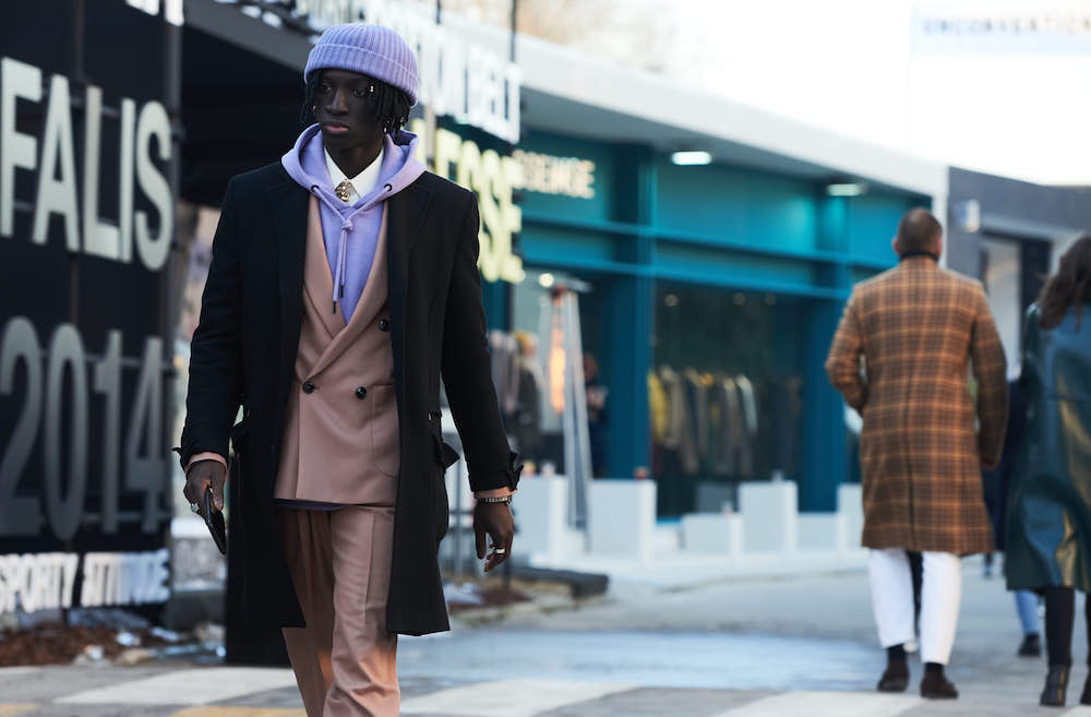 Florence street style looks celebrate traditional menswear with gender-neutral accessories at Pitti Immagine Uomo's 97th edition.