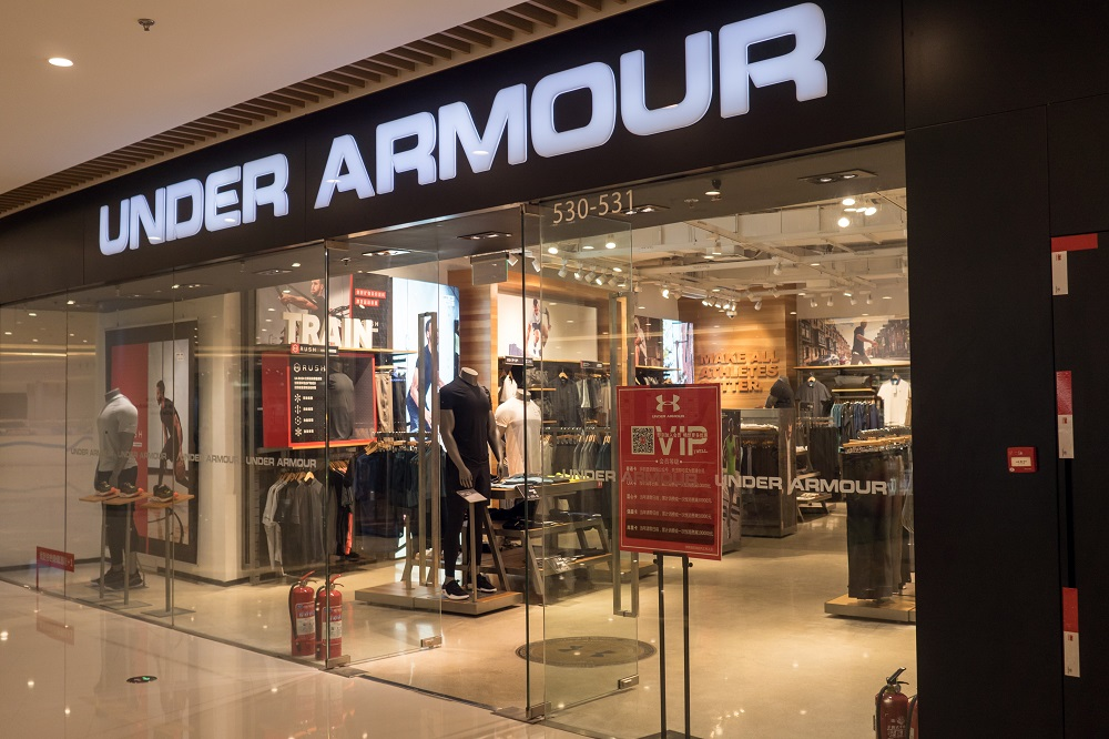 Under Armour said it was considering a restructuring initiative that could involve nixing plans for a New York City flagship.