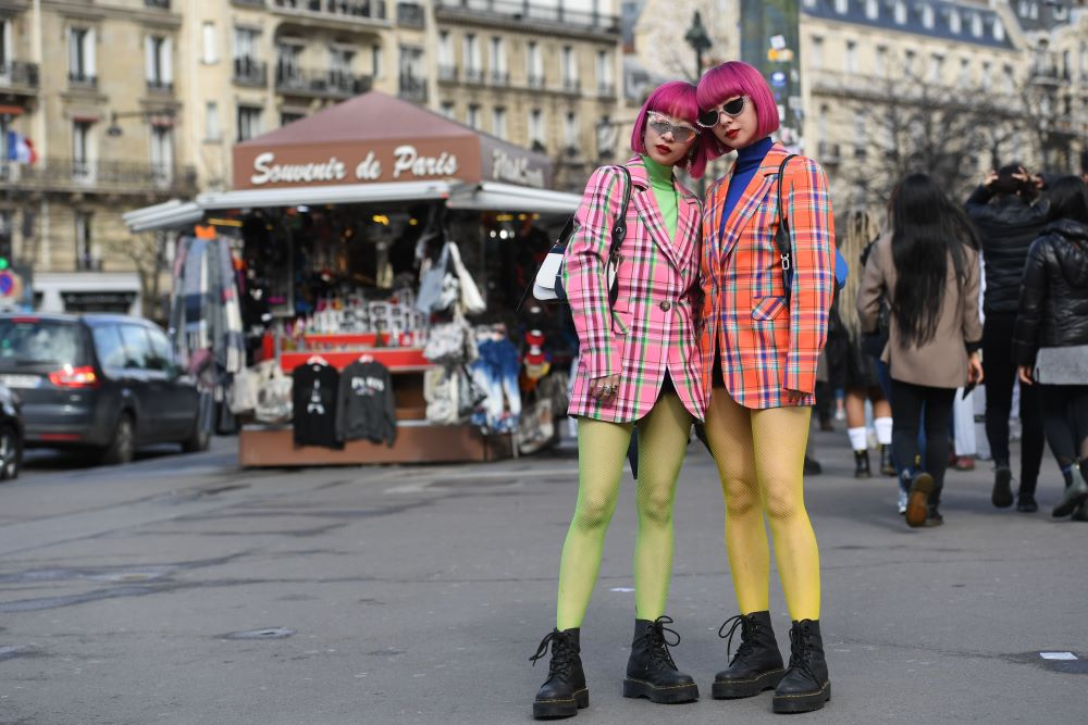 Ami Suzuki and Aya Suzuki don Dr. Martens with colorful ensembles at Paris Fashion Week last March. At Platform in Las Vegas Wednesday, NPD's Beth Goldstein said 2020 footwear trends will focus on casual comfort and utilitarian design.