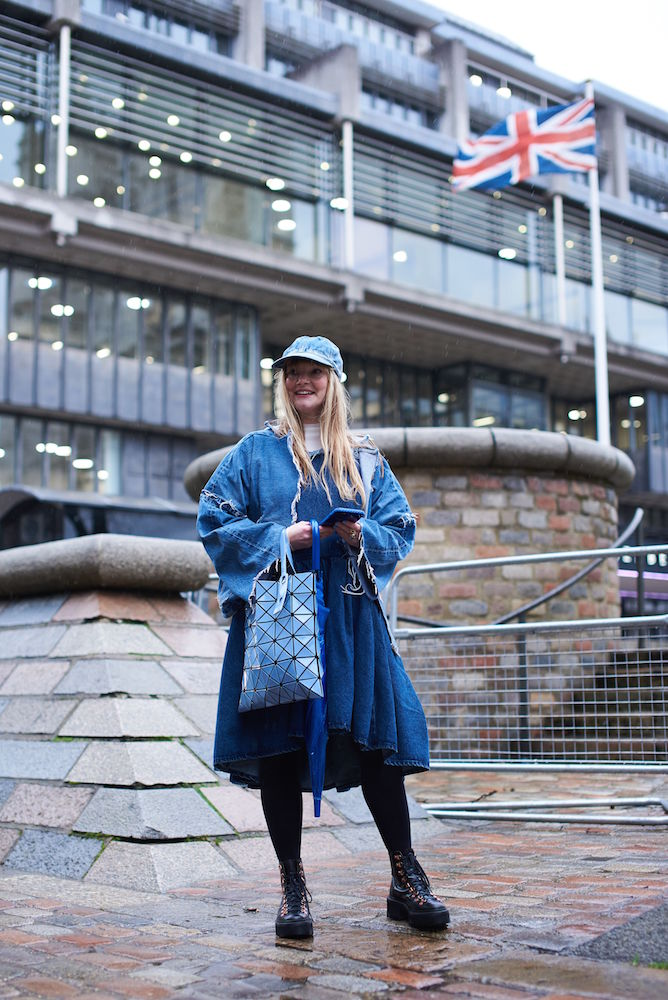 Kelly Harrington at London Fashion Week. With windy rain putting a damper on London Fashion Week, the street style set chose classic blue jeans to get them through long days.