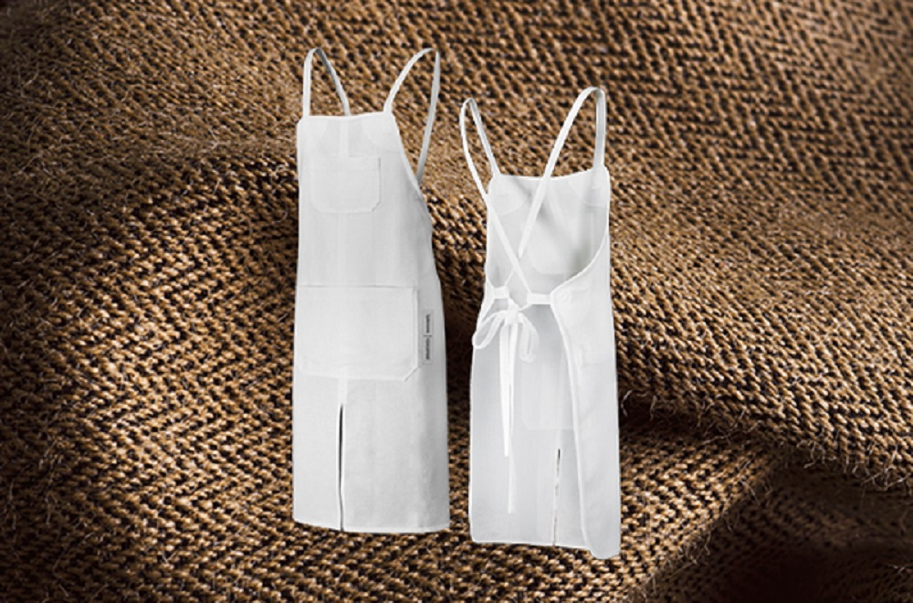 Finnish sustainable workwear company Touchpoint and material innovation firm Spinnova have introduced their first demo, the Tapio apron.