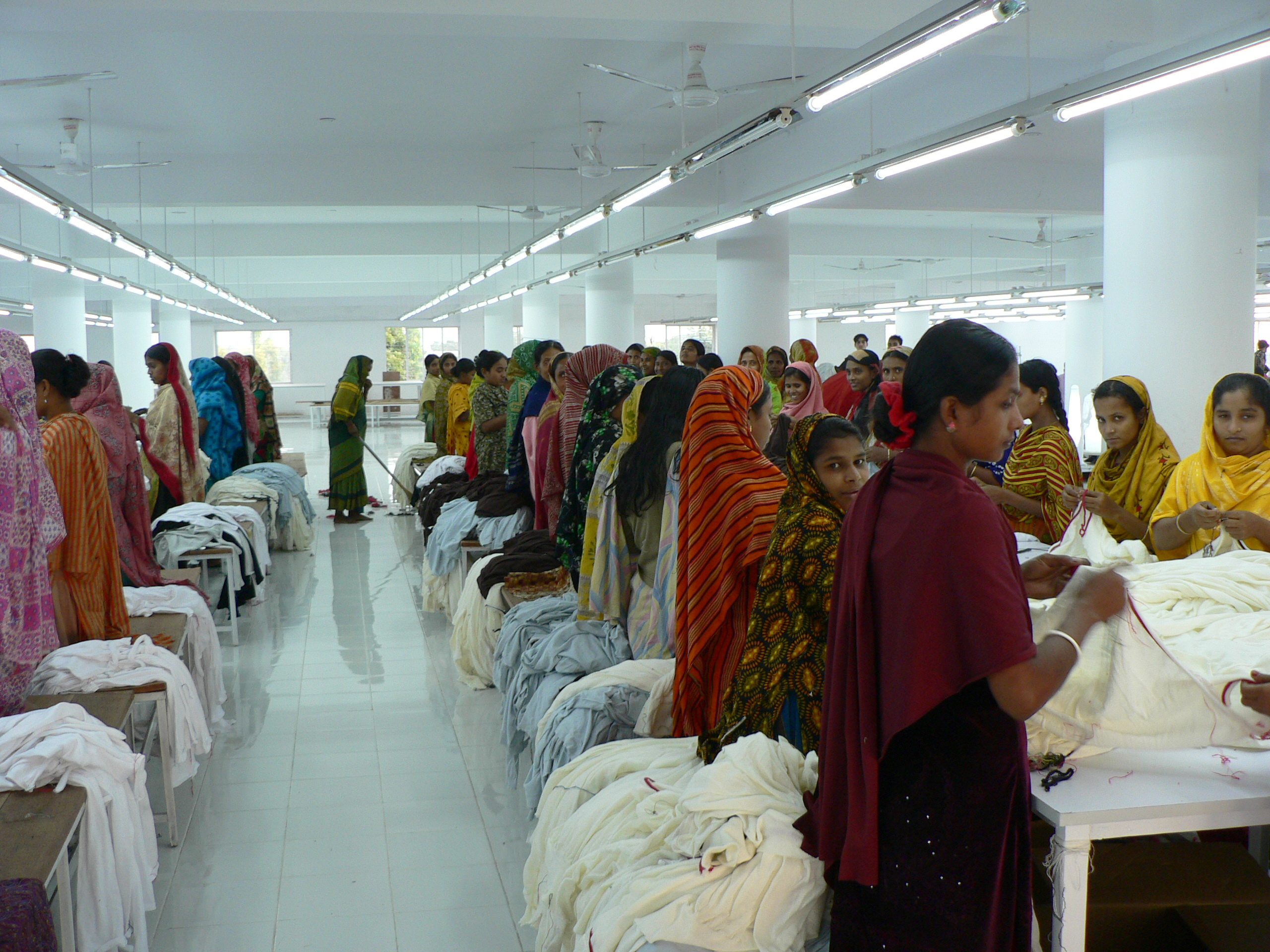 Hardworking people in the textile factory Dhaka Bangladesh November 2007