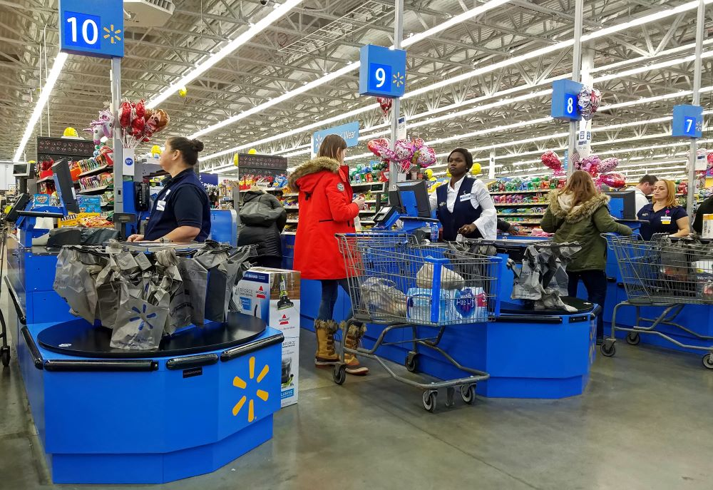 Walmart and Target will award bonuses to hourly workers in April and Walmart expects to hire 150,000 temporary employees to stem demand