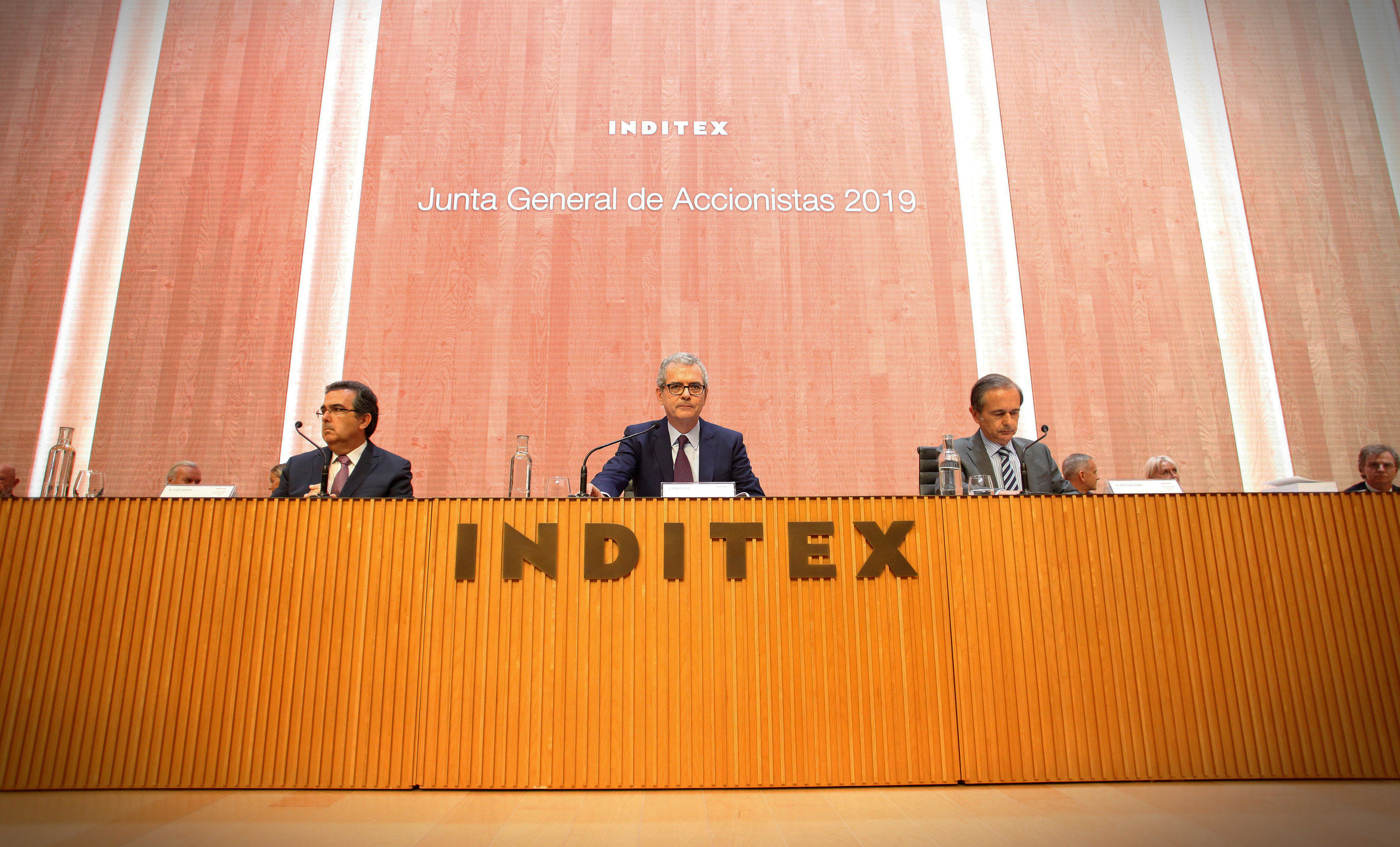 Spanish textile retail giant Inditex' Executive Chairman, Pablo Isla (C), chairs the general meeting of shareholders in the town of Arteixo, La Coruna, northwestern Spain, 16 July 2019