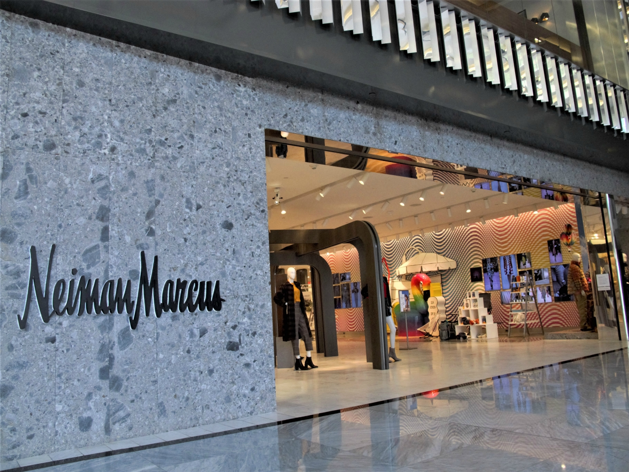 With a Neiman Marcus bankruptcy filing said to be close, HBC's Richard Baker could be the white knight to acquire the luxury retailer.