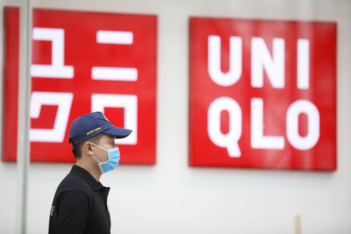 Fast Retailing's first-half revenues and profits suffered from the coronavirus outbreak, impacting its Uniqlo fashion business globally.