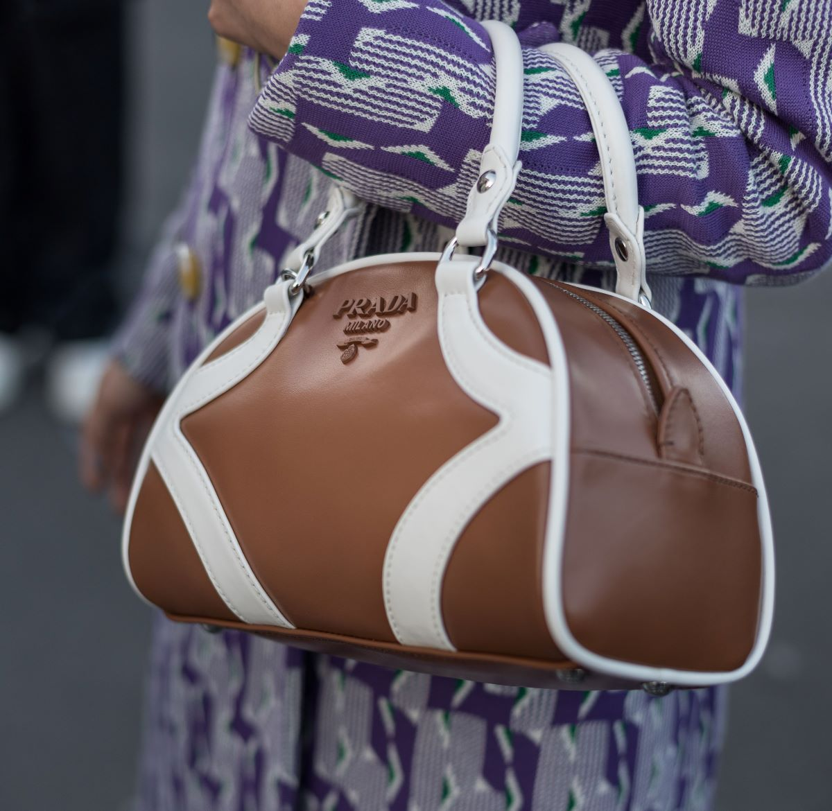 """Italian luxury house Prada is restarting manufacturing with """"cutting edge"""" safety protocols that involve double-screening employees."""