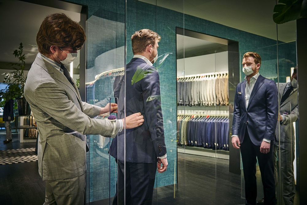 Suitsupply's free-standing Safe Shopping Screens within its fitting rooms.