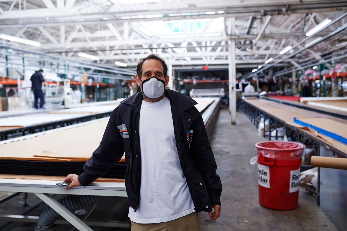 Dov Charney's Los Angeles Apparel is facing claims from the Garment Workers Center that it has done little to curb a coronavirus outbreak.