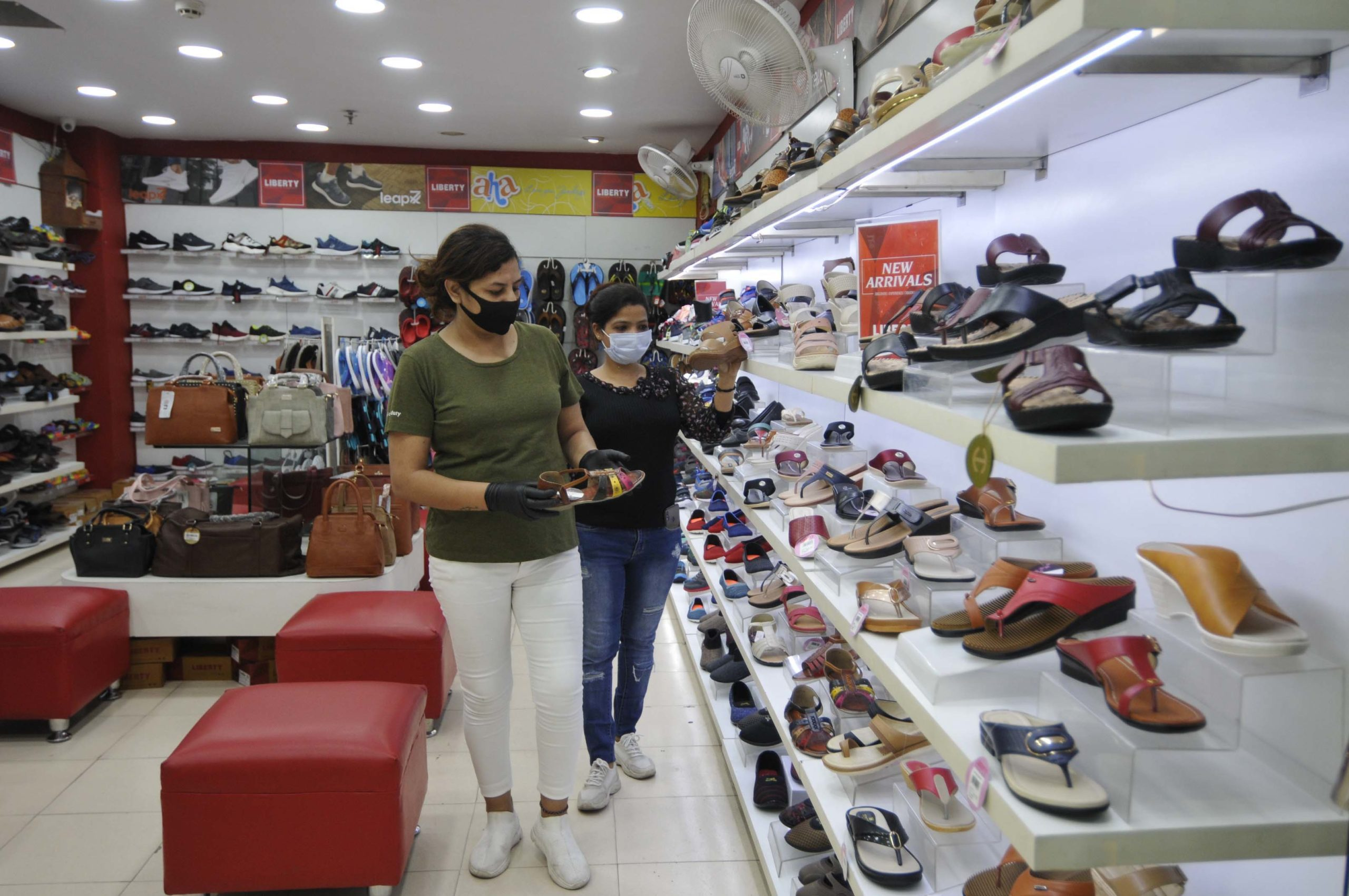 People shop inside a footwear store in Smart Bharat Mall in Noida, India.