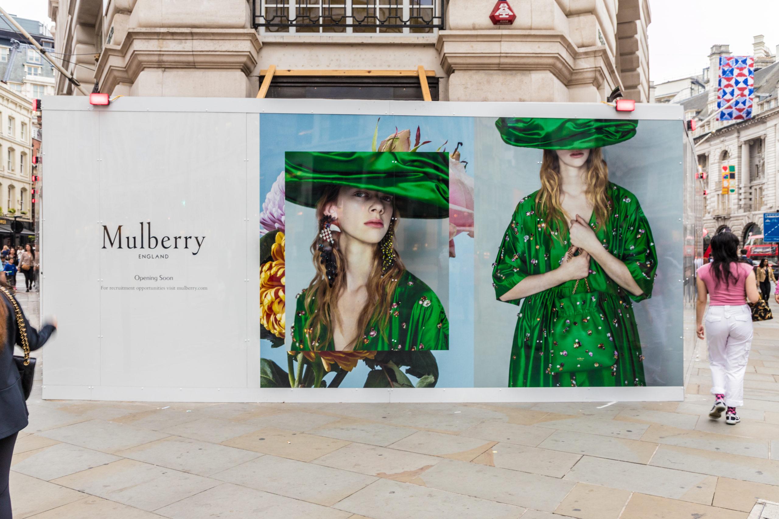 LA view of wooden hoarding advertising Mulberry on regent street in London
