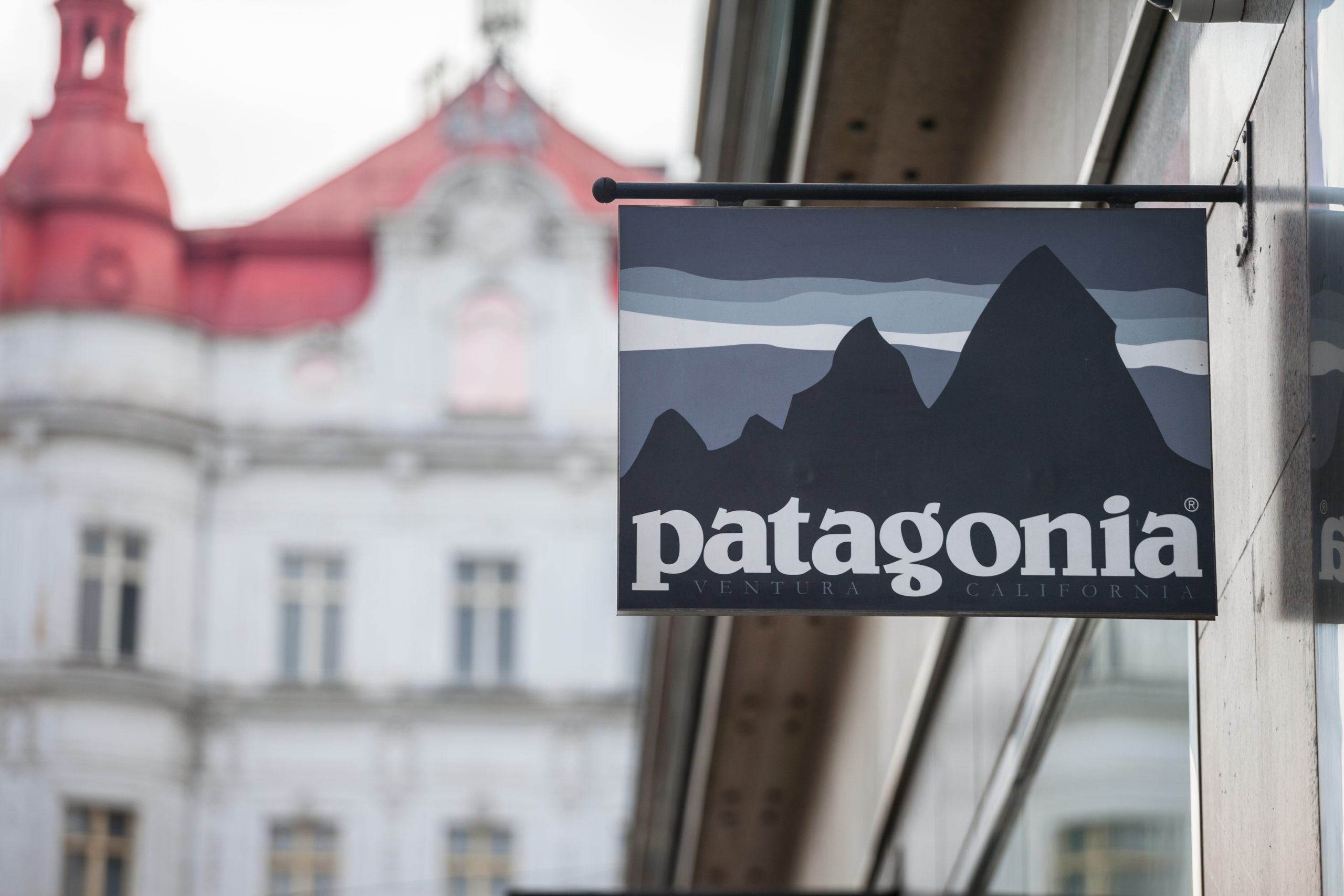 Patagonia logo in front of their store in Prague. Patagonia is an American brand of outdoor fashion, sportswear and sports gear.